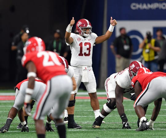 Alabama quarterback Tua Tagovailoa  signals at the line of scrimmage against the Georgia the 2018 SEC championship game.