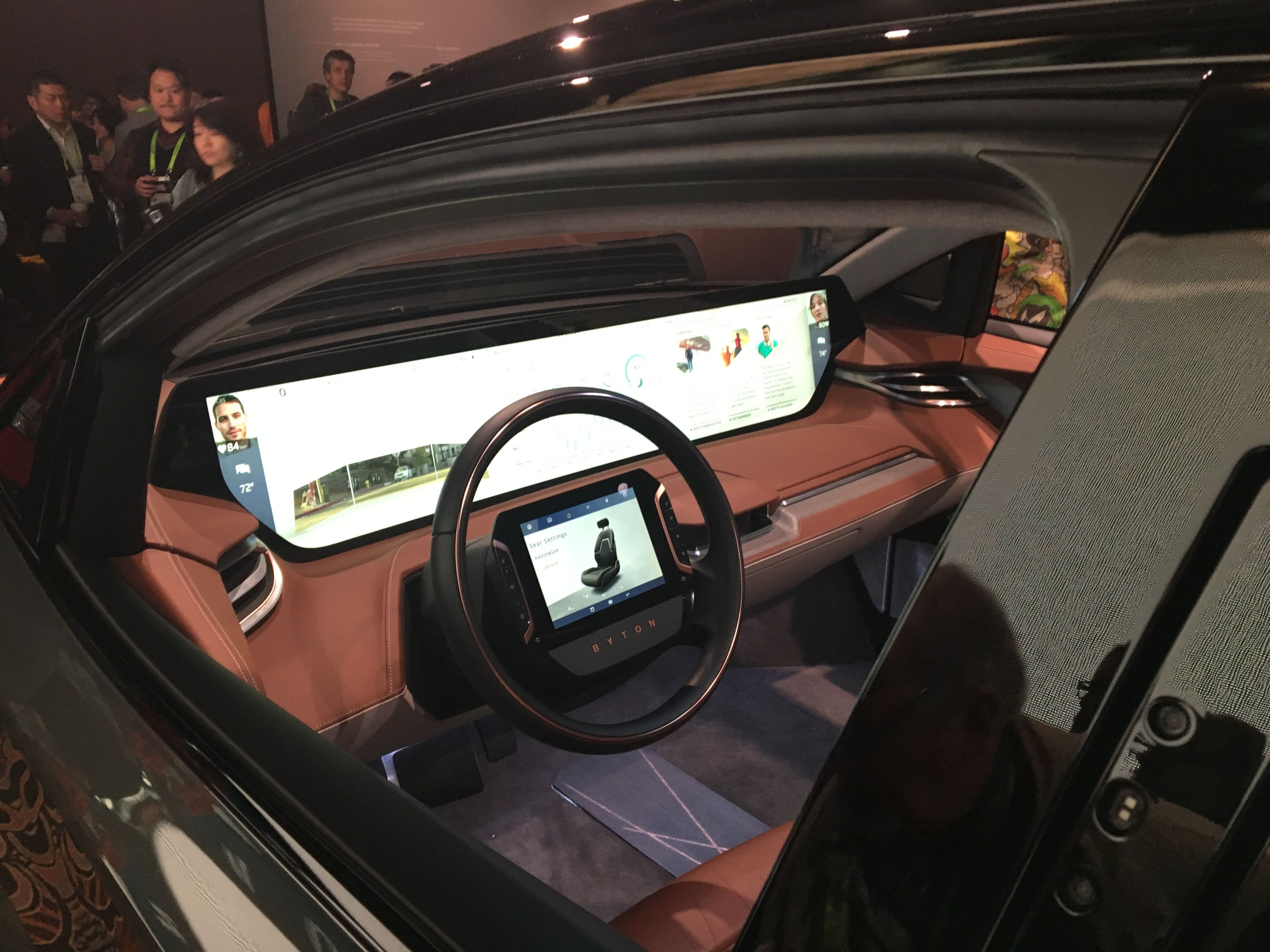 An electronic vehicle produced by China based automotive startup Byton features a 48 inch display and is set to go on sale later this year.