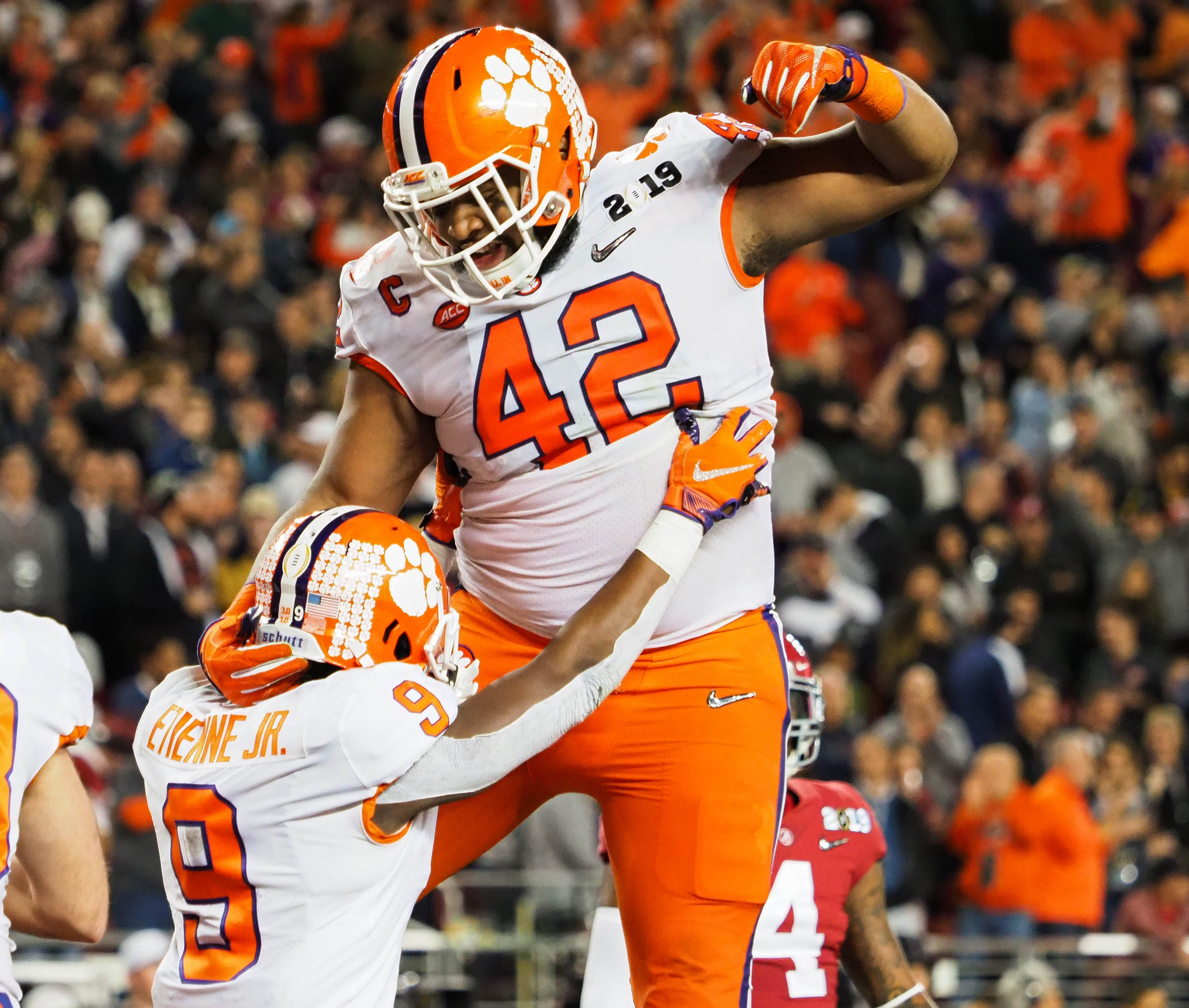 Clemson running back Travis Etienne (9) celebrates his touchdown aginst Alabama with defensive lineman Christian Wilkins during the second quarter during the 2019 College Football Playoff championship game.