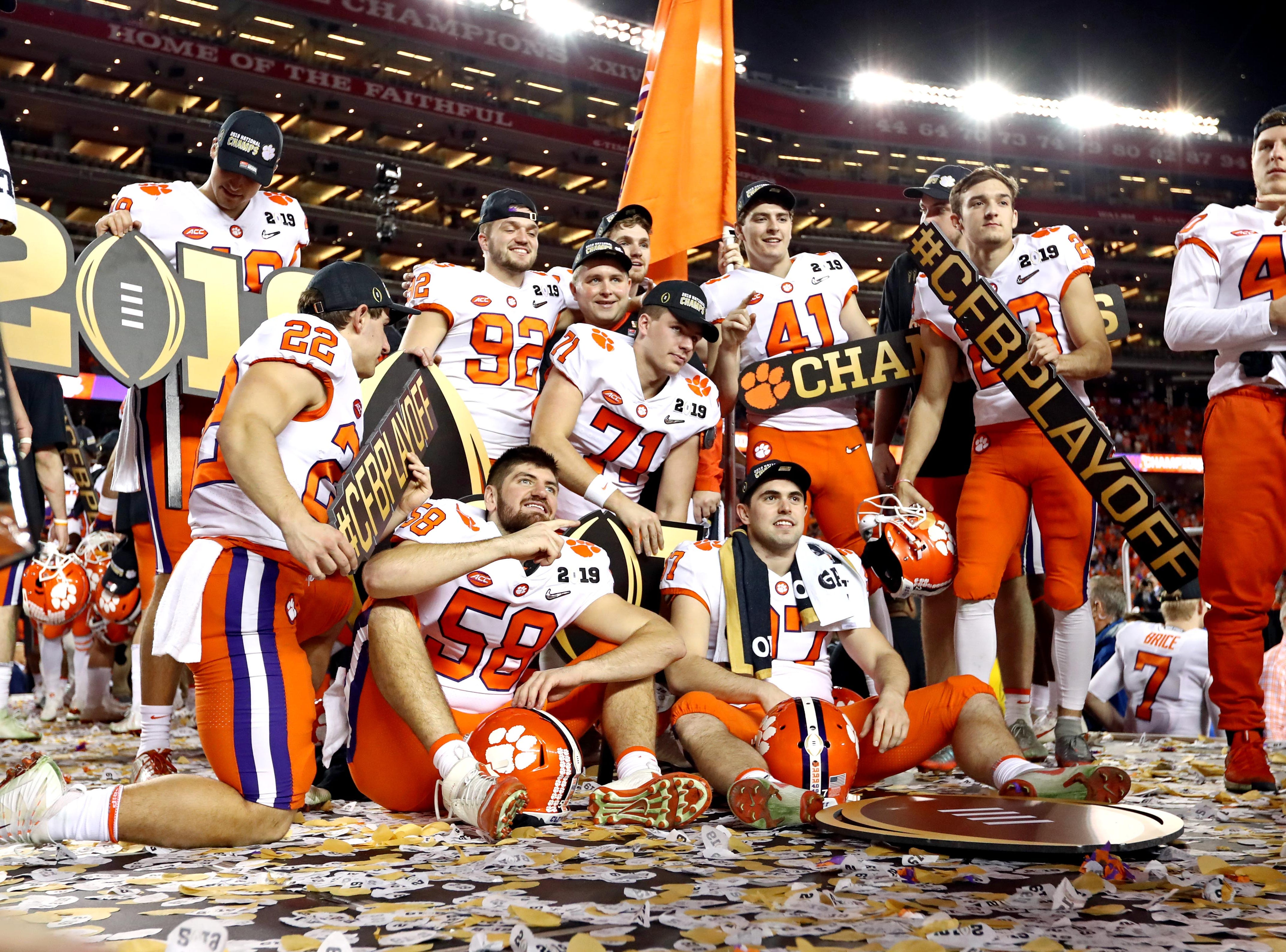 The Clemson Tigers celebrate after beating the Alabama Crimson Tide.