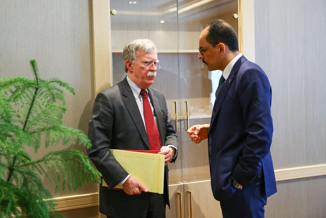 A handout photo made available by Turkish Presidential Press Office shows Turkish Presidential Spokesperson Ibrahim Kalin (R) and US National Security Advisor John Bolton (L) during their meeting in Ankara, Turkey, 08 January 2019. According to reports, Turkish President Recep Tayyip Erdogan criticized recent remarks made by US National Security Advisor John Bolton on Kurdish militants in Syria. Bolton on 07 January in Israel said that US troops would not leave Syria until Turkey agrees not to attack Kurdish forces in Syria.