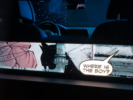 The Batman comic book shows on the back of a self-driving car screen, as it prepares to rise when the drive begins, in a futuristic concept car from Intel and Warner Bros.