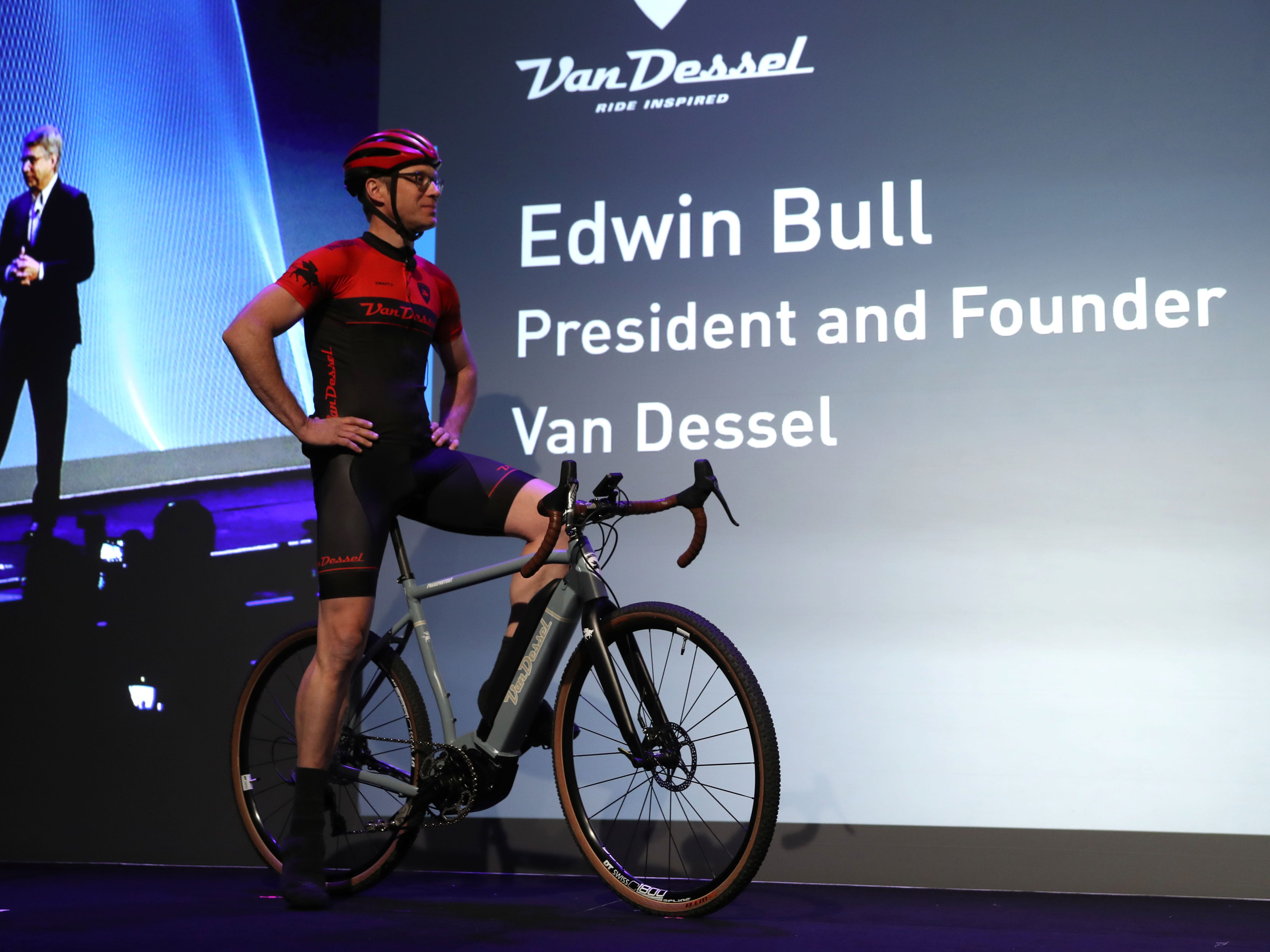 Van Dessel President and Founder Edwin Bull on an electric bicycle.