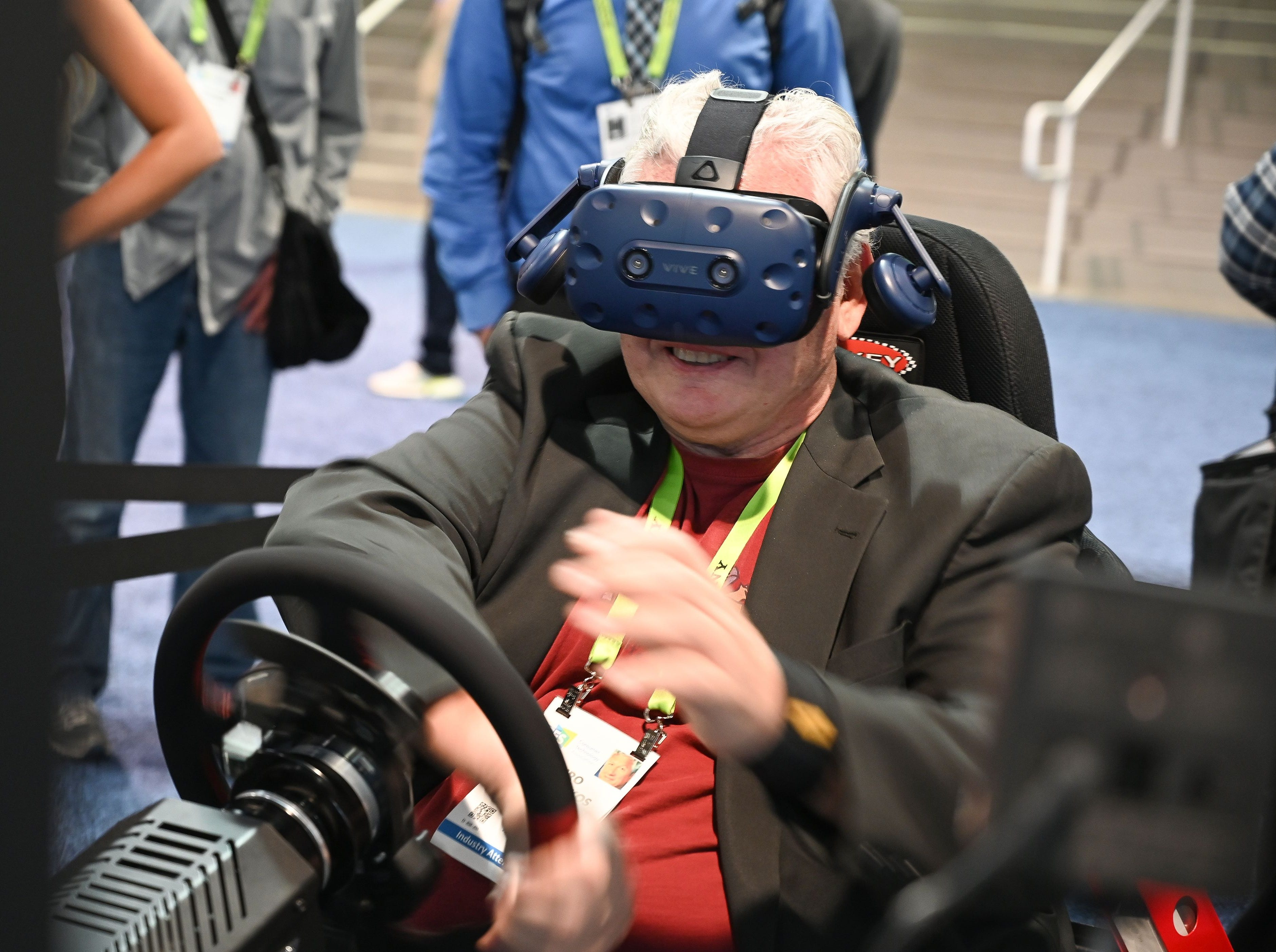 An attendee wears a HTC Vive virtual reality headset as he tries a Simxperience in-home auto racing simulator at the Earthquake booth during CES 2019 on January 8, 2019 at the Las Vegas Convention Center in Las Vegas, Nevada. (Photo by Robyn Beck / AFP)ROBYN BECK/AFP/Getty Images ORIG FILE ID: AFP_1C29N7