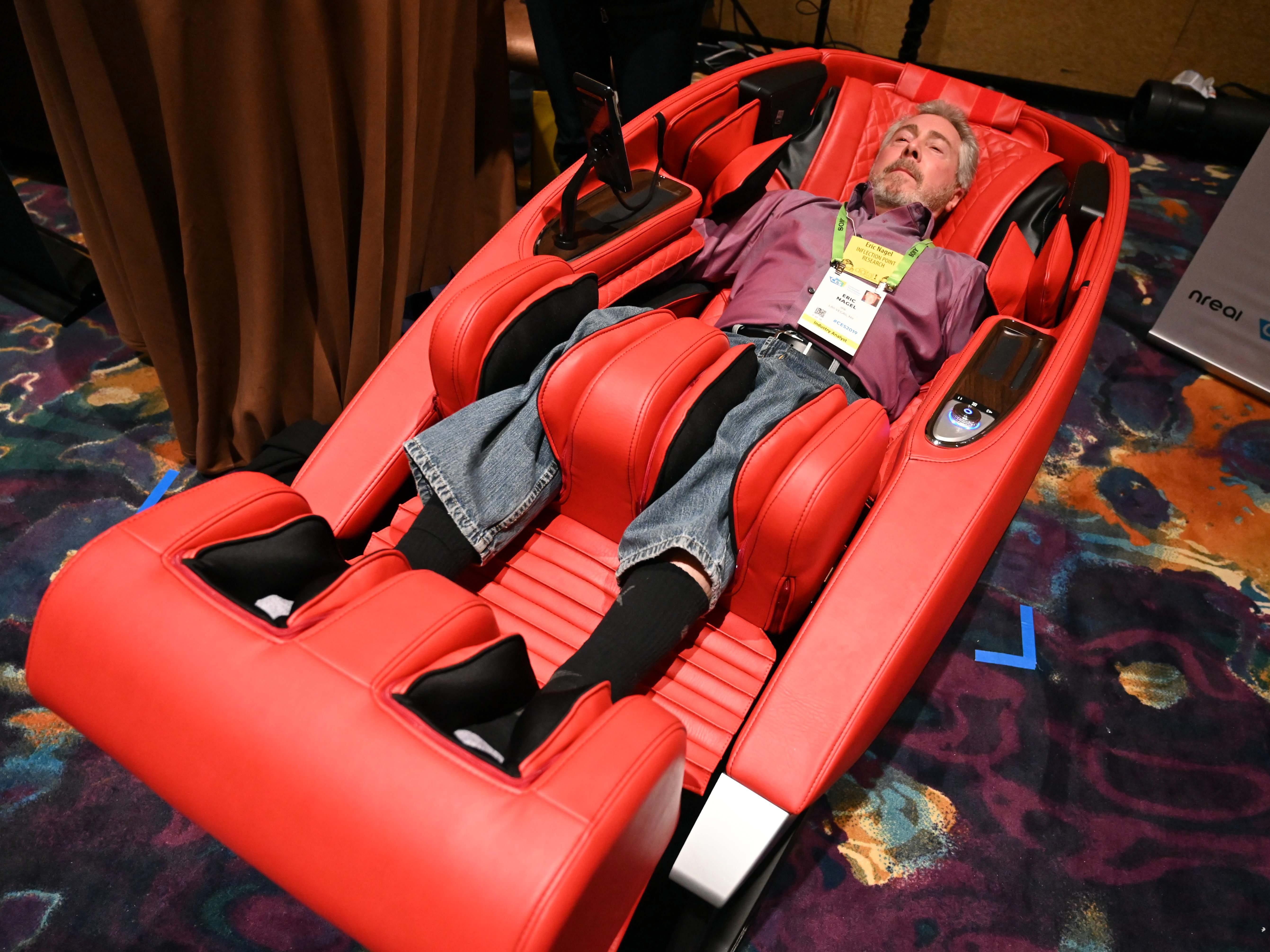 Eric Nagel relaxes in the Super Novo massage chair at the Human Touch booth.