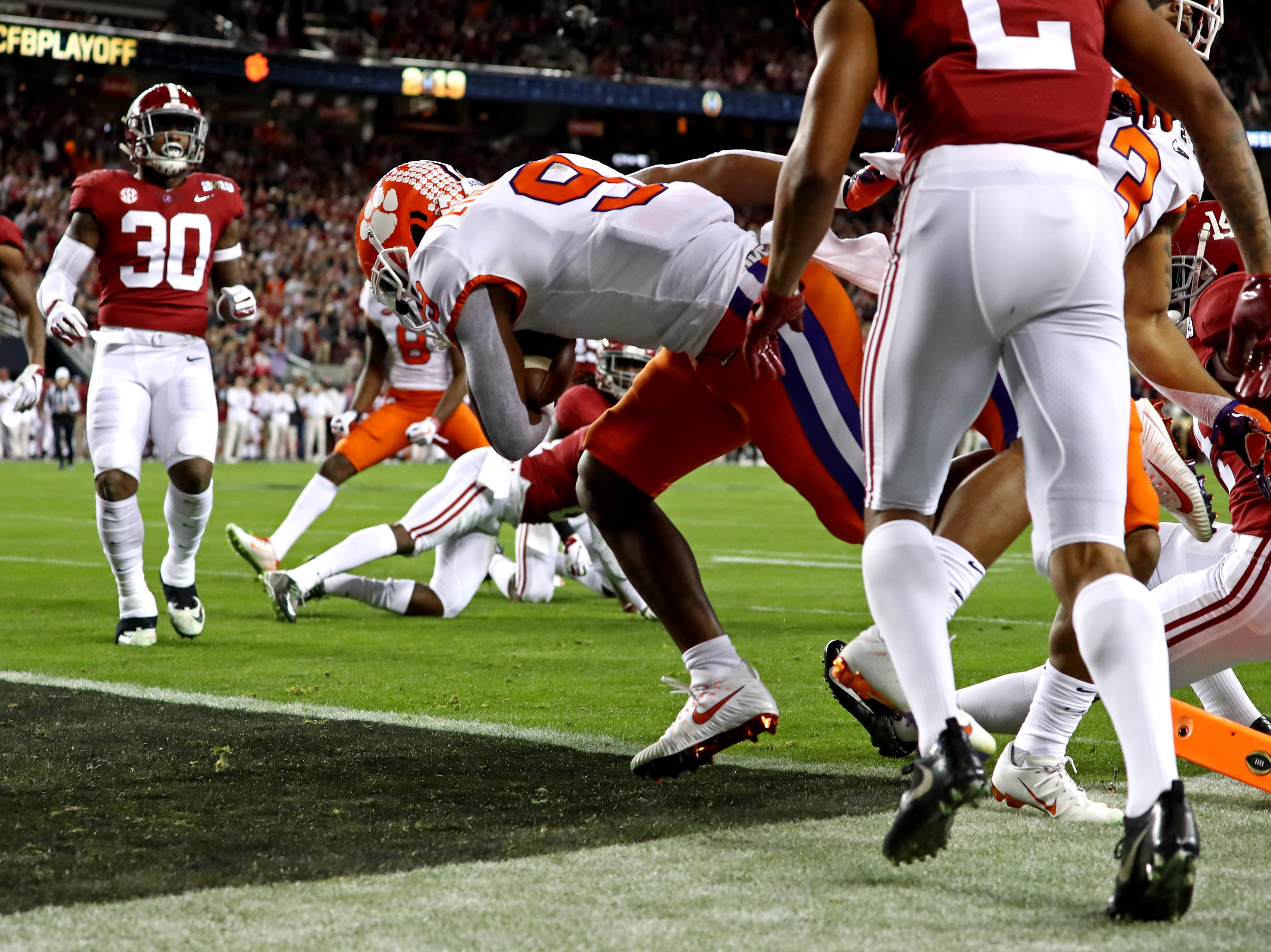 Clemson running back Travis Etienne scores a touchdown in the first quarter.