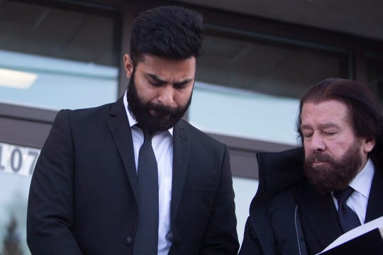 Jaskirat Singh Sidhu left provincial court with his lawyer on Tuesday.
