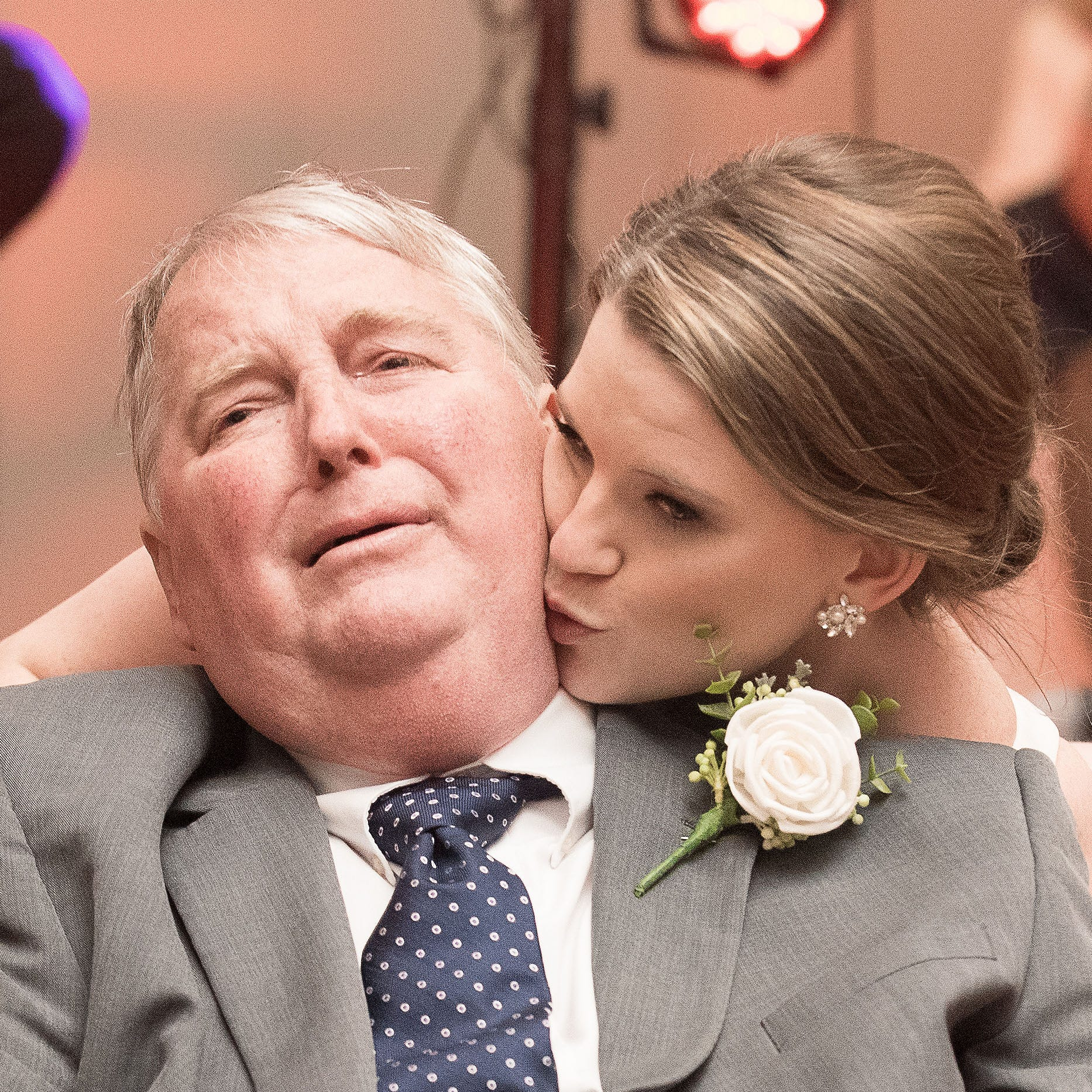 Mary Bourne Butts dances with her terminally ill father during her wedding reception.