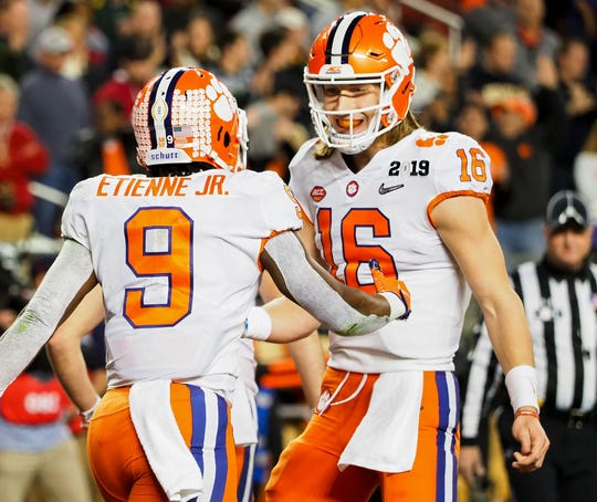 Clemson quarterback Trevor Lawrence celebrate a touchdown in the second quarter against Alabama in the College Football Playoff championship game.