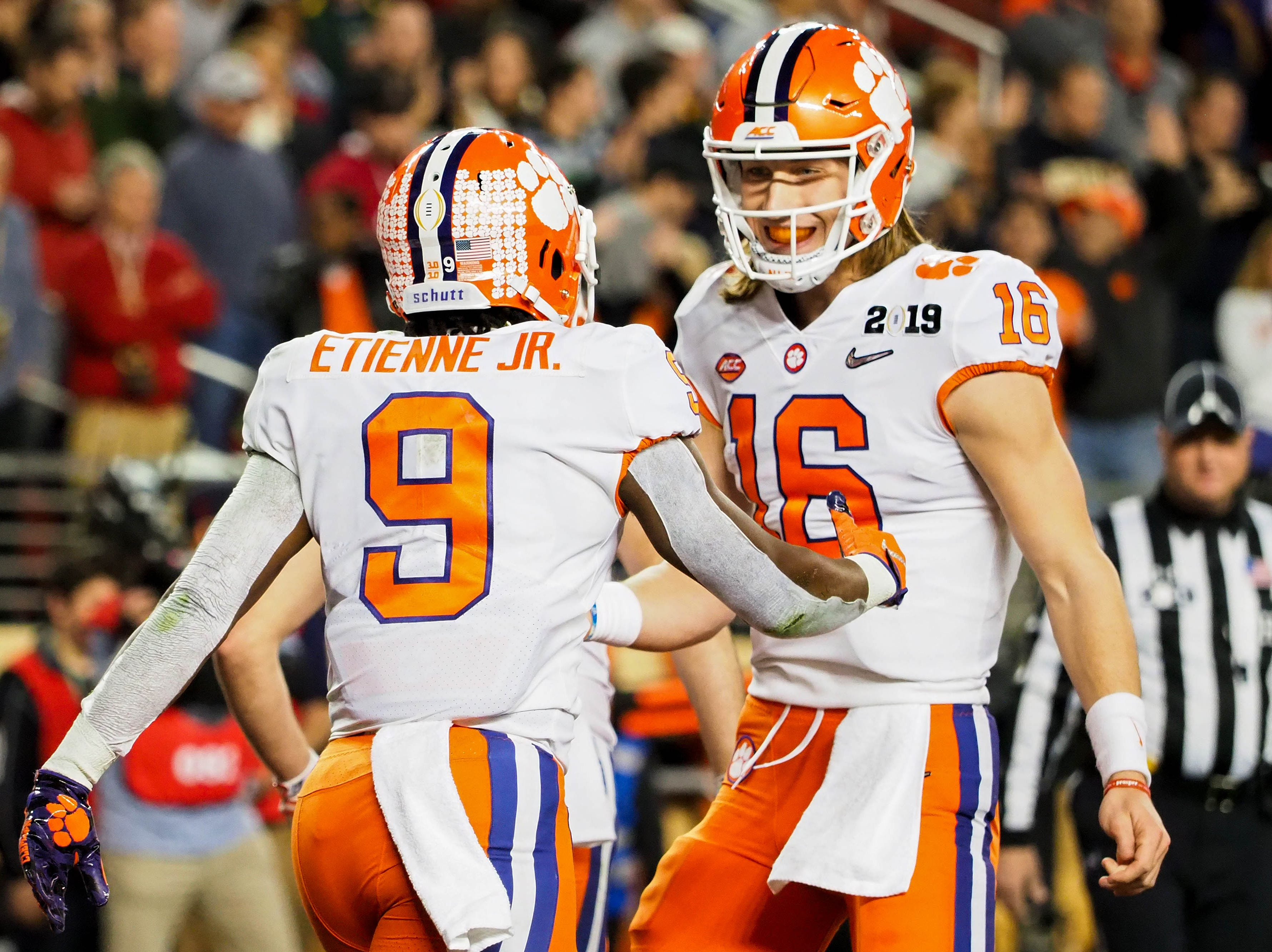 Clemson running back Travis Etienne and quarterback Trevor Lawrence celebrate a touchdown in the second quarter.