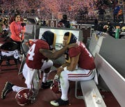 Damien Harris consoles Tua Tagovailoa	after Alabama lost the national championship game to Clemson.