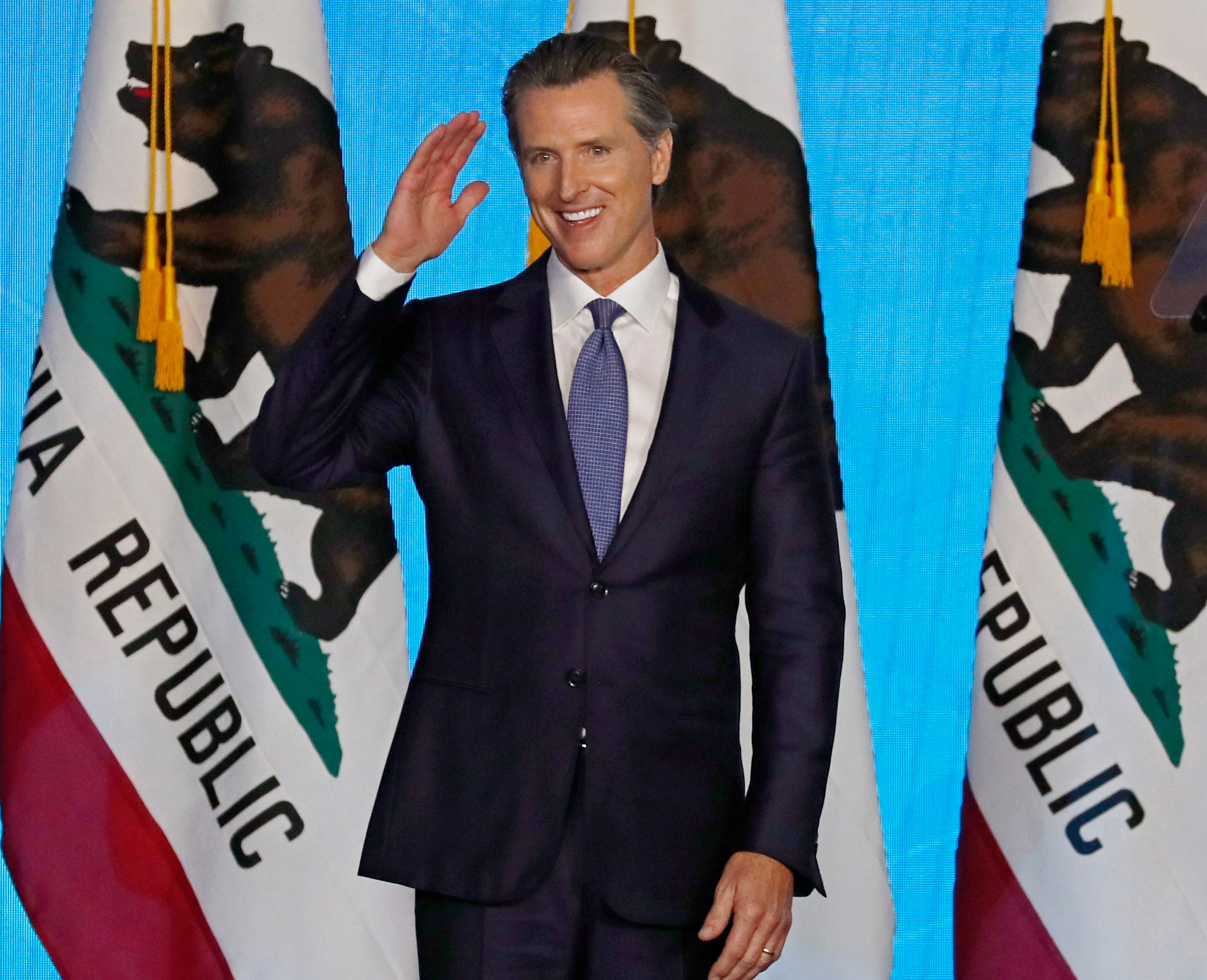 California Governor Gavin Newsom gestures after he was sworn in during his inauguration ceremony at the State Capitol in Sacramento.