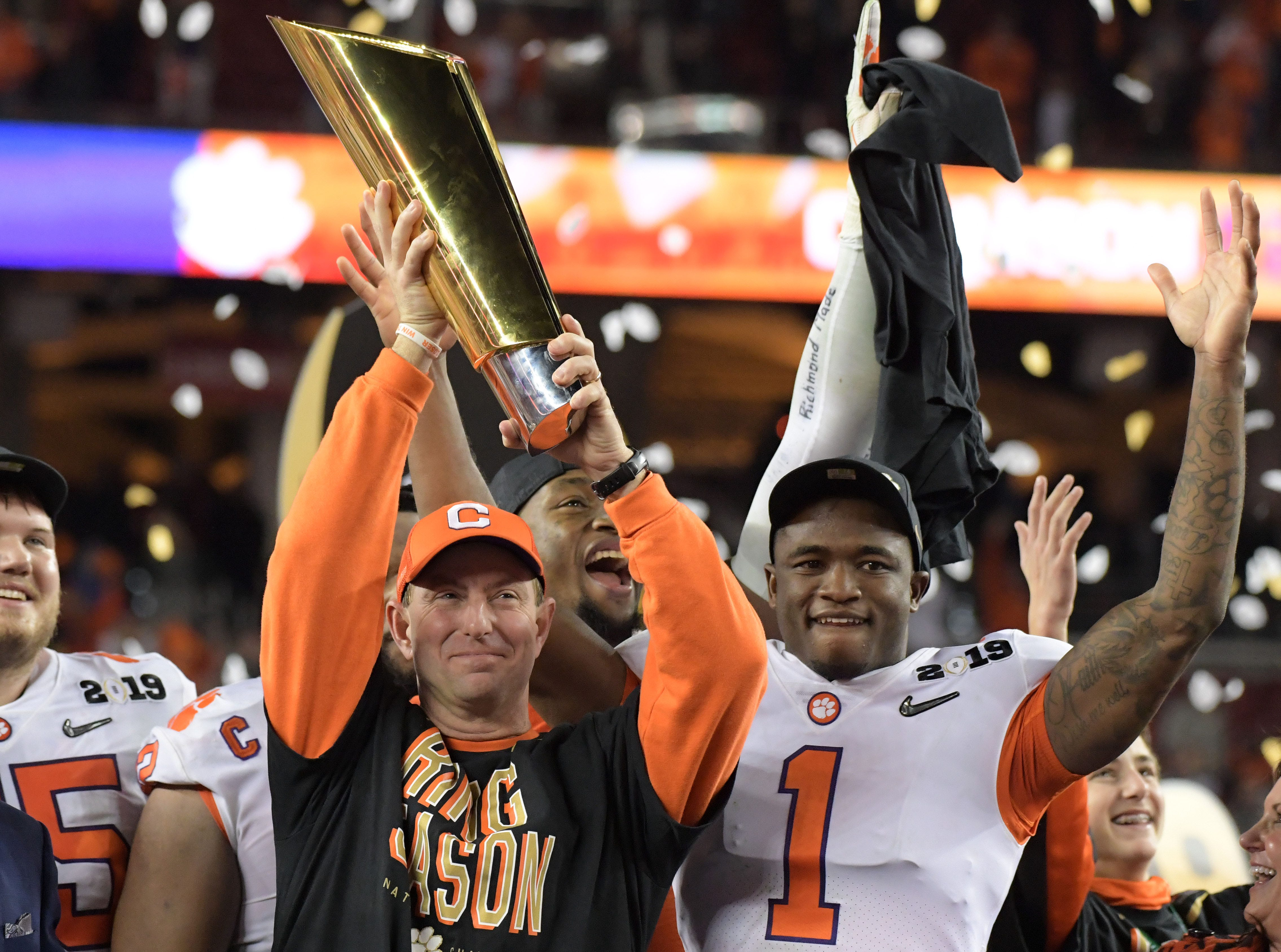 Clemson Tigers head coach Dabo Swinney celebrates with the College Football Playoff National Championship trophy.