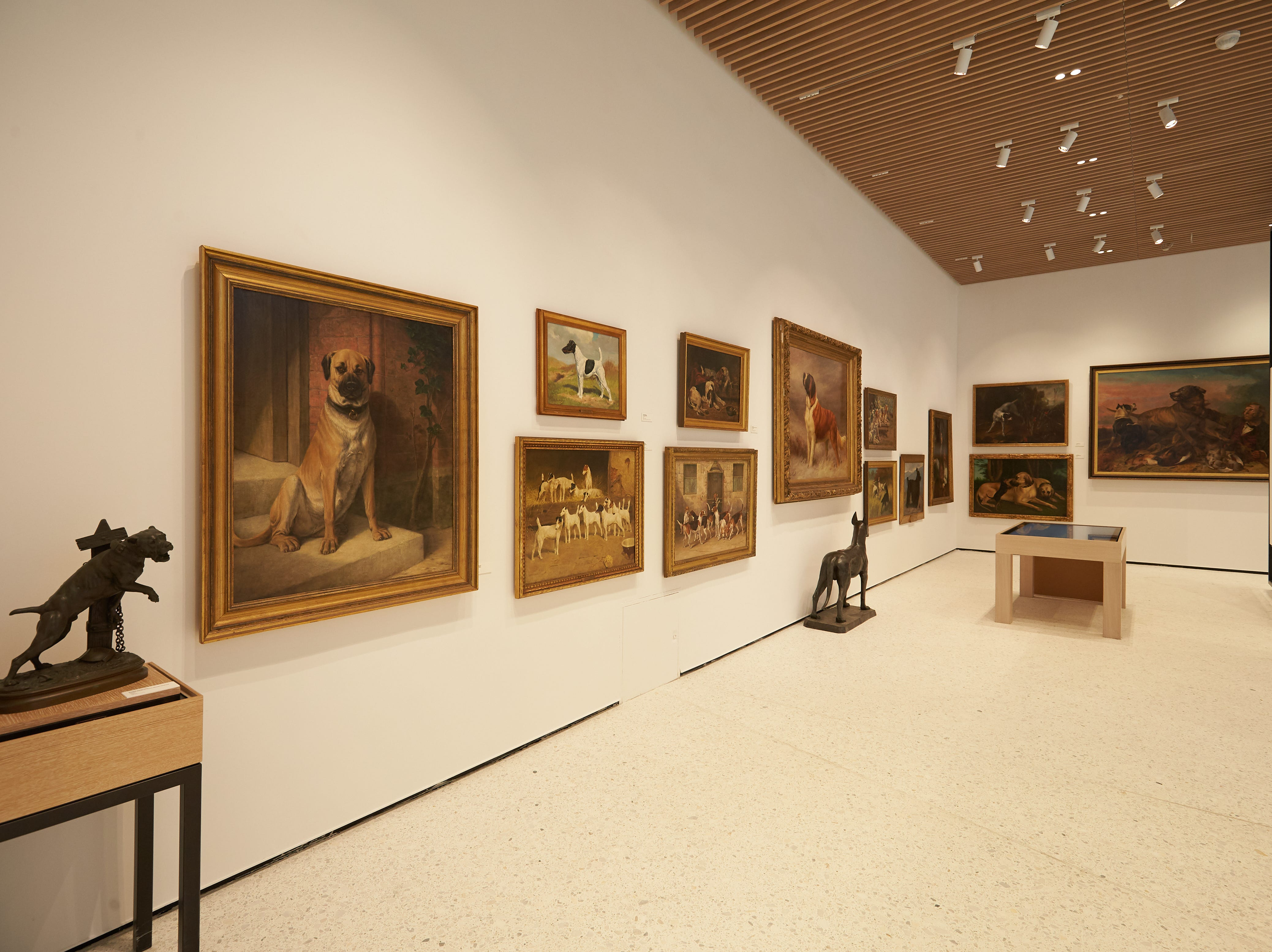 """The Museum of the Dog features paintings and sculptures by well-known artists. The gallery includes interactive exhibits such as a """"Find Your Match"""" kiosk that takes your photo and determines which AKC-registered dog breed you look like."""