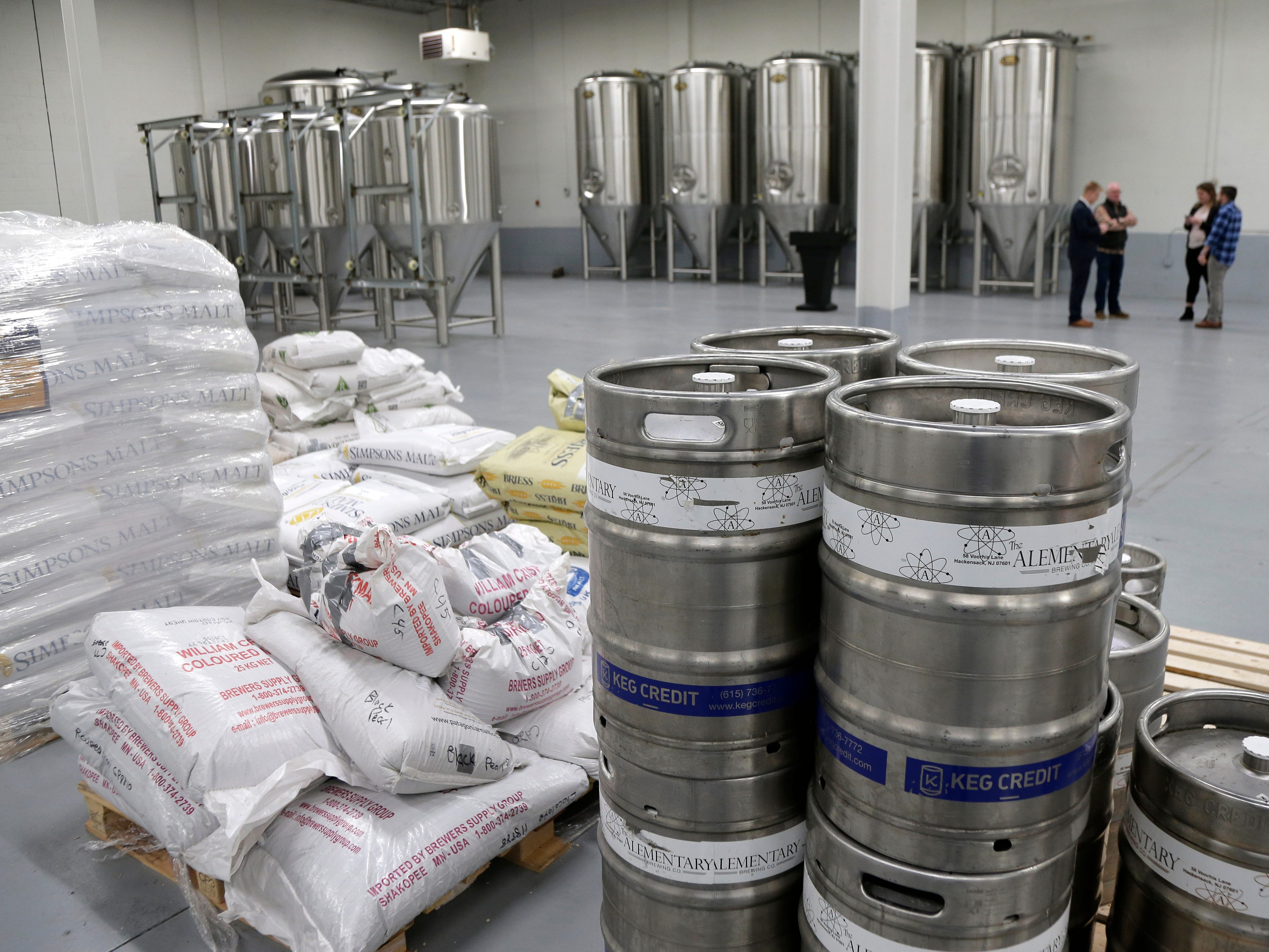 New brewing equipment, rear, sits idle in a warehouse used by the Alementary Brewing Co. in Hackensack, N.J., Jan. 7, 2019. The owners recently invested in one million dollars worth of new equipment and a new 13,000 sq ft warehouse which would increase their capacity five times, but due to the government shutdown, they have been unable to get the required licenses from the Alcohol and Tobacco Tax and Trade Bureau.