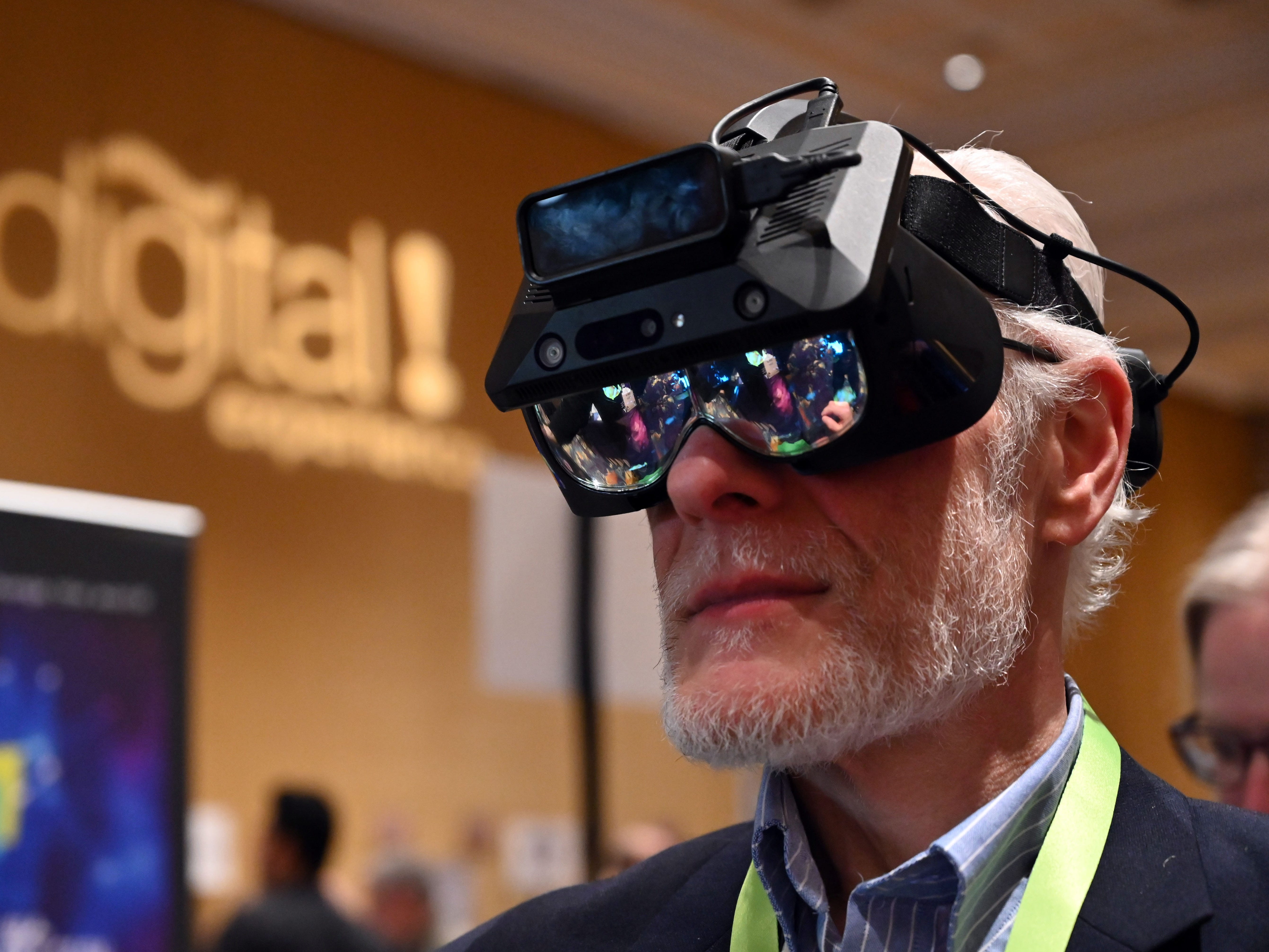 Jack Gold, tries the Realmax 100 degree mobile Augmented Reality Glasses.