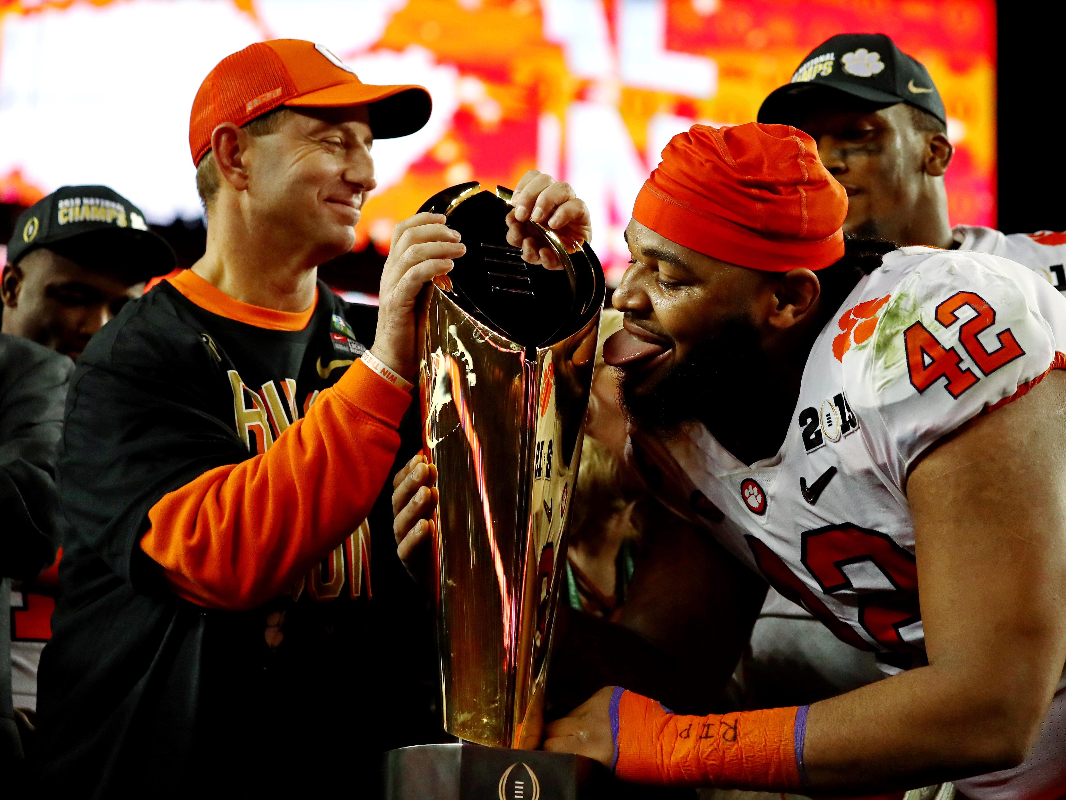 Clemson defensive lineman Christian Wilkins celebrates with the national championship trophy after beating Alabama in the College Football Playoff title game.