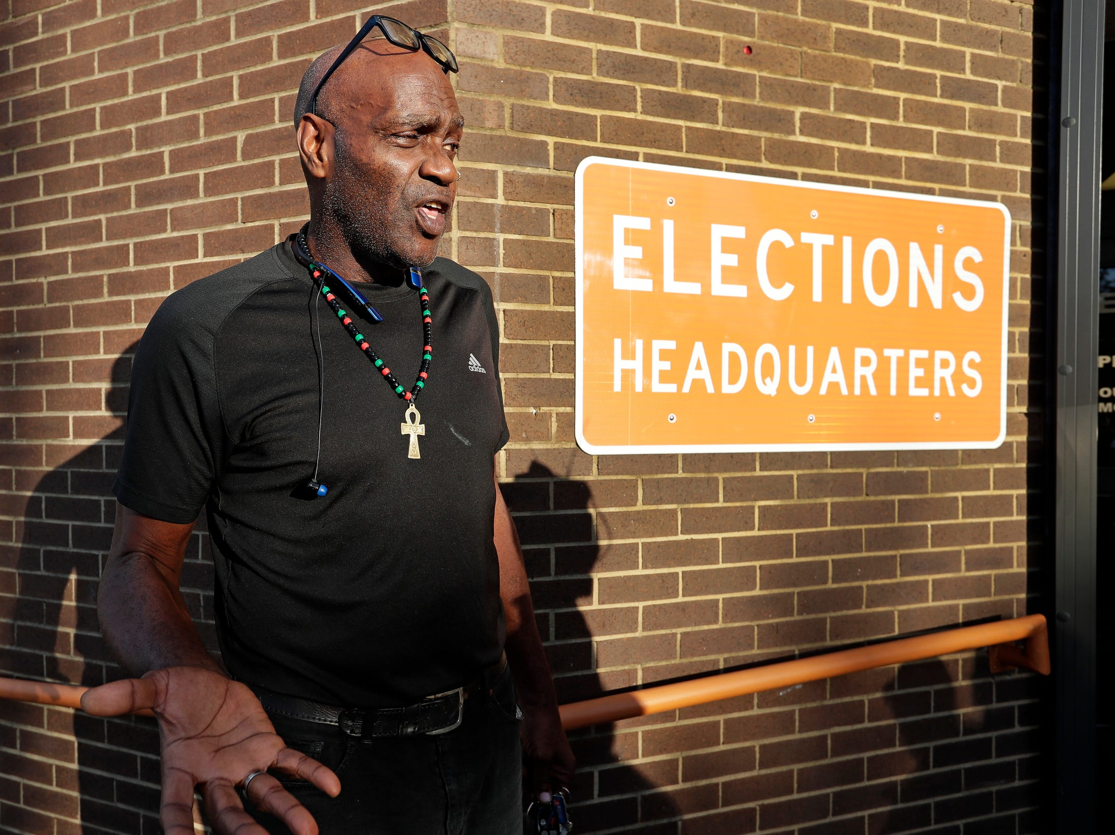 Former felon Robert Eckerd talks with reporters after registering to vote at the Supervisor of Elections office Tuesday, in Orlando, Fla.