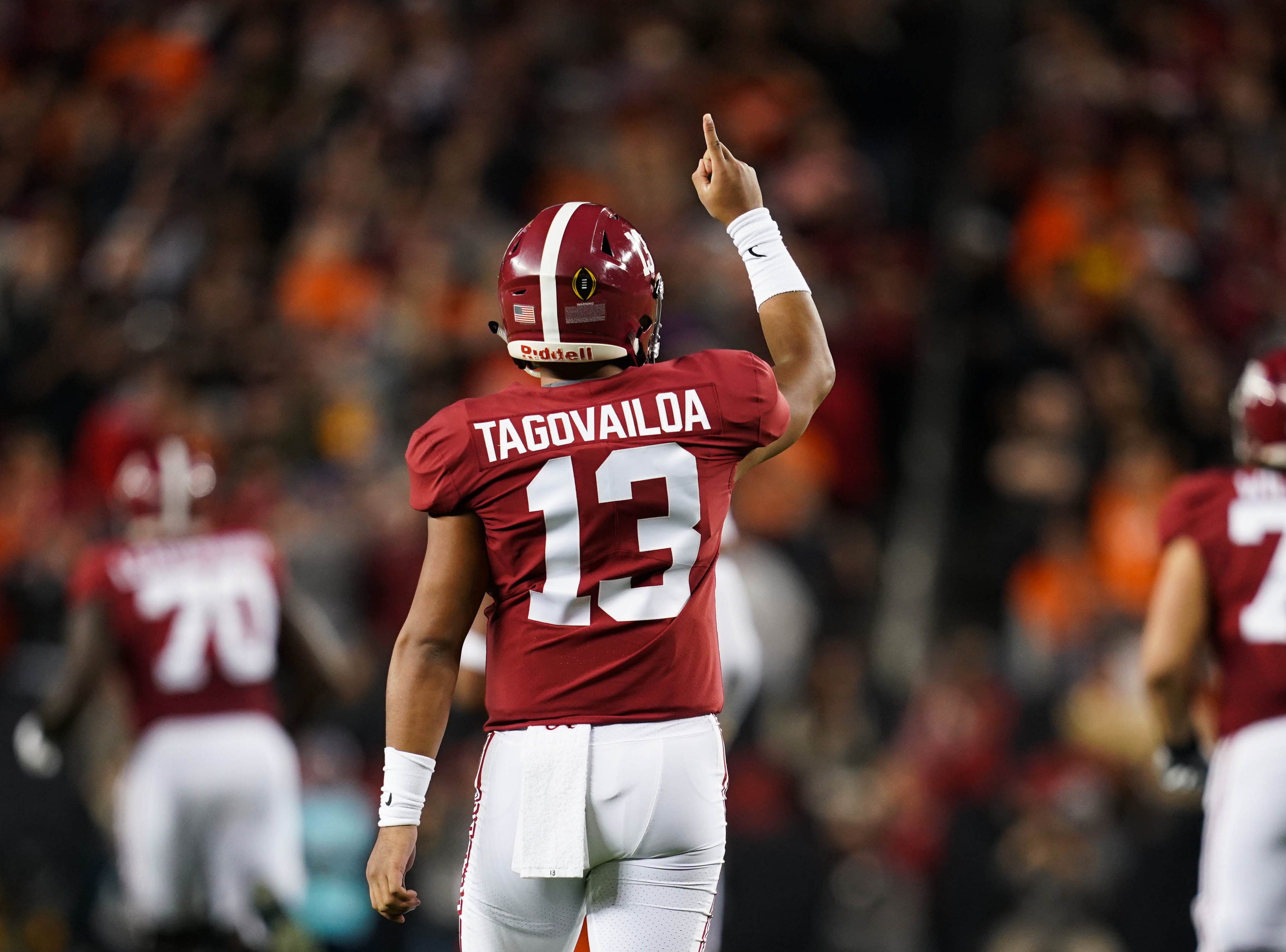 Alabama quarterback Tua Tagovailoa celebrates during the first quarter.