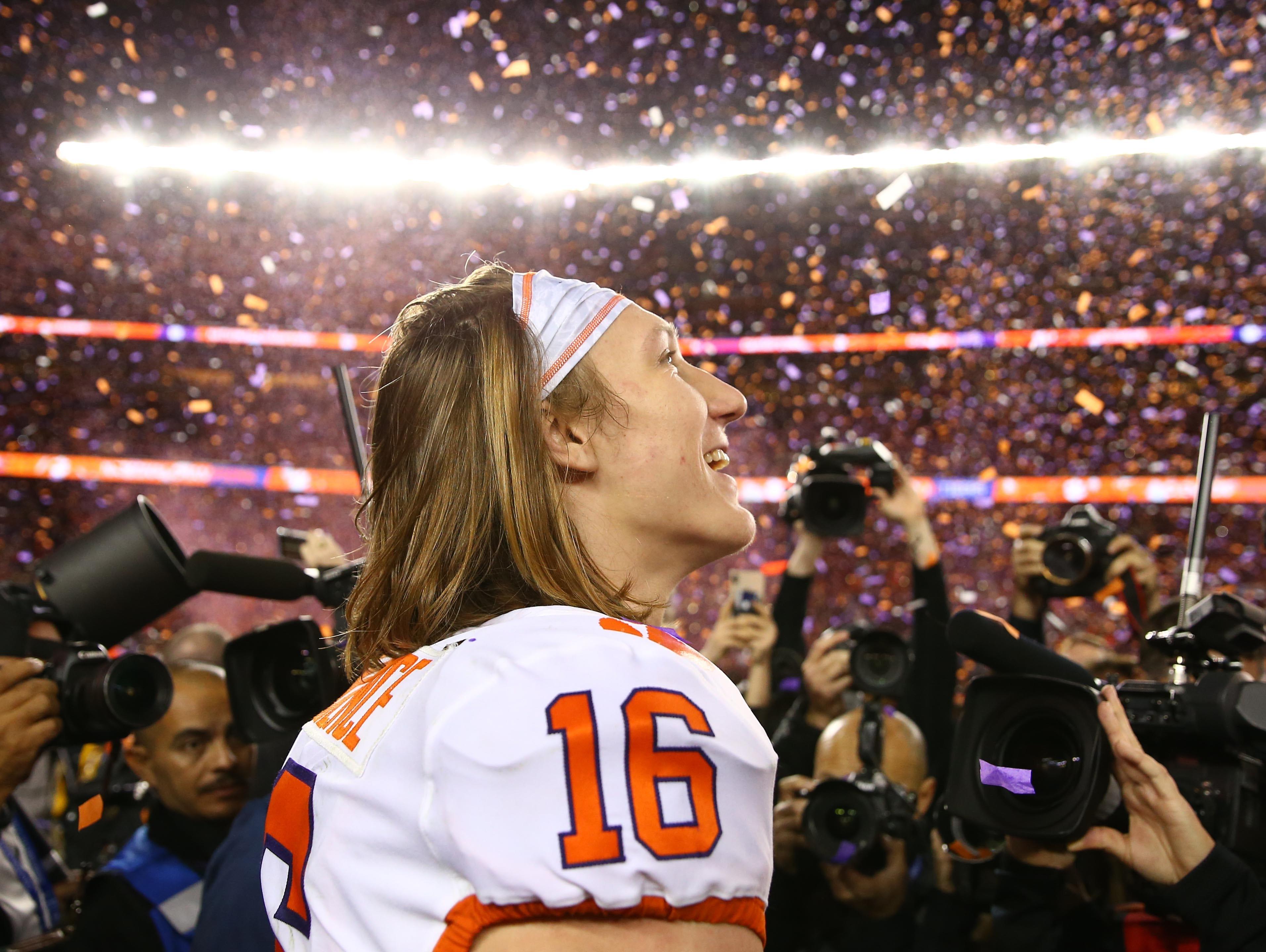 Clemson quarterback Trevor Lawrence celebrates after the win.