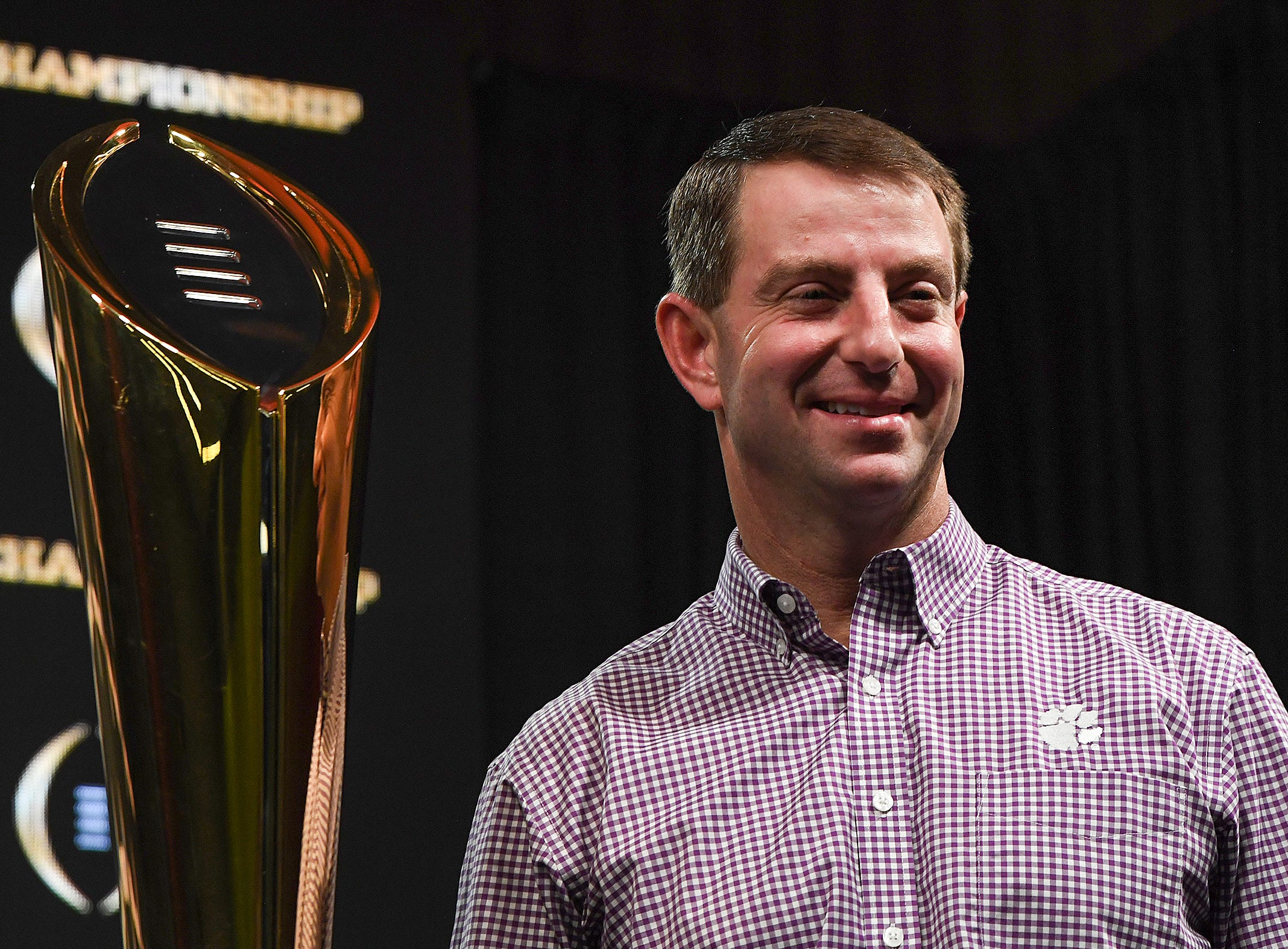 Clemson head coach Dabo Swinney stands with the College Football National Championship trophy during a press conference in San Jose, CA Tuesday, January 8, 2019.