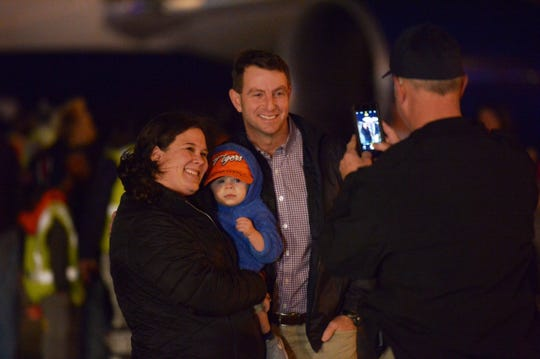 Dabo Swinney takes a photograph with fans after landing at Greenville-Spartanburg International Airport Tuesday night.