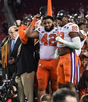 Clemson defensive lineman Christian Wilkins (42) and defensive lineman Clelin Ferrell (99) celebrate a 44-16 win over Alabama after the College Football Championship game at Levi's Stadium in Santa Clara, California Monday, January 7, 2019.