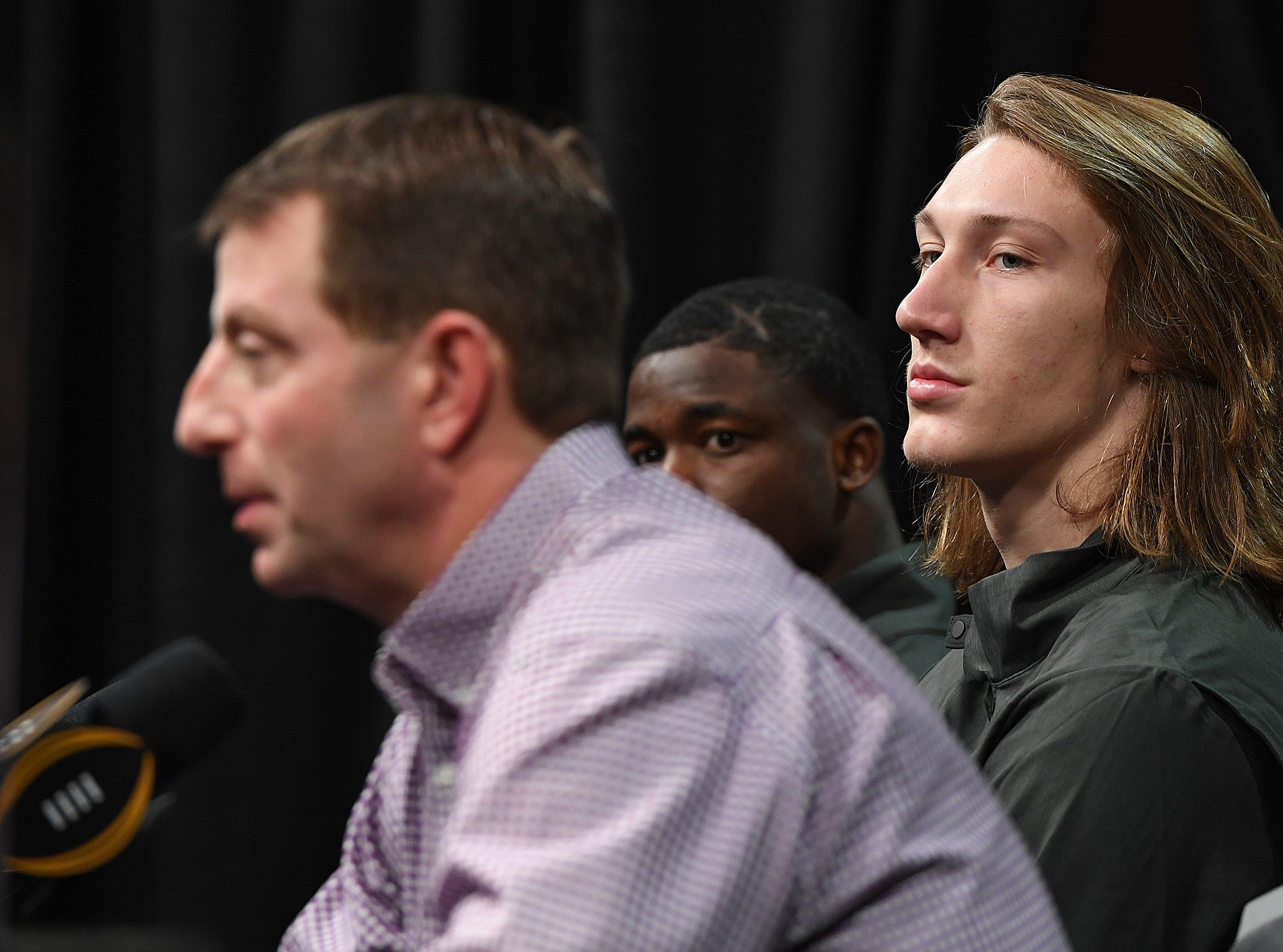 Clemson head coach Dabo Swinney answers questions during the College Football National Championship press conference in San Jose, CA Tuesday, January 8, 2019. With Swinney are defensive MVP cornerback Trayvon Mullen, left, and offensive MVP quarterback Trevor Lawrence.