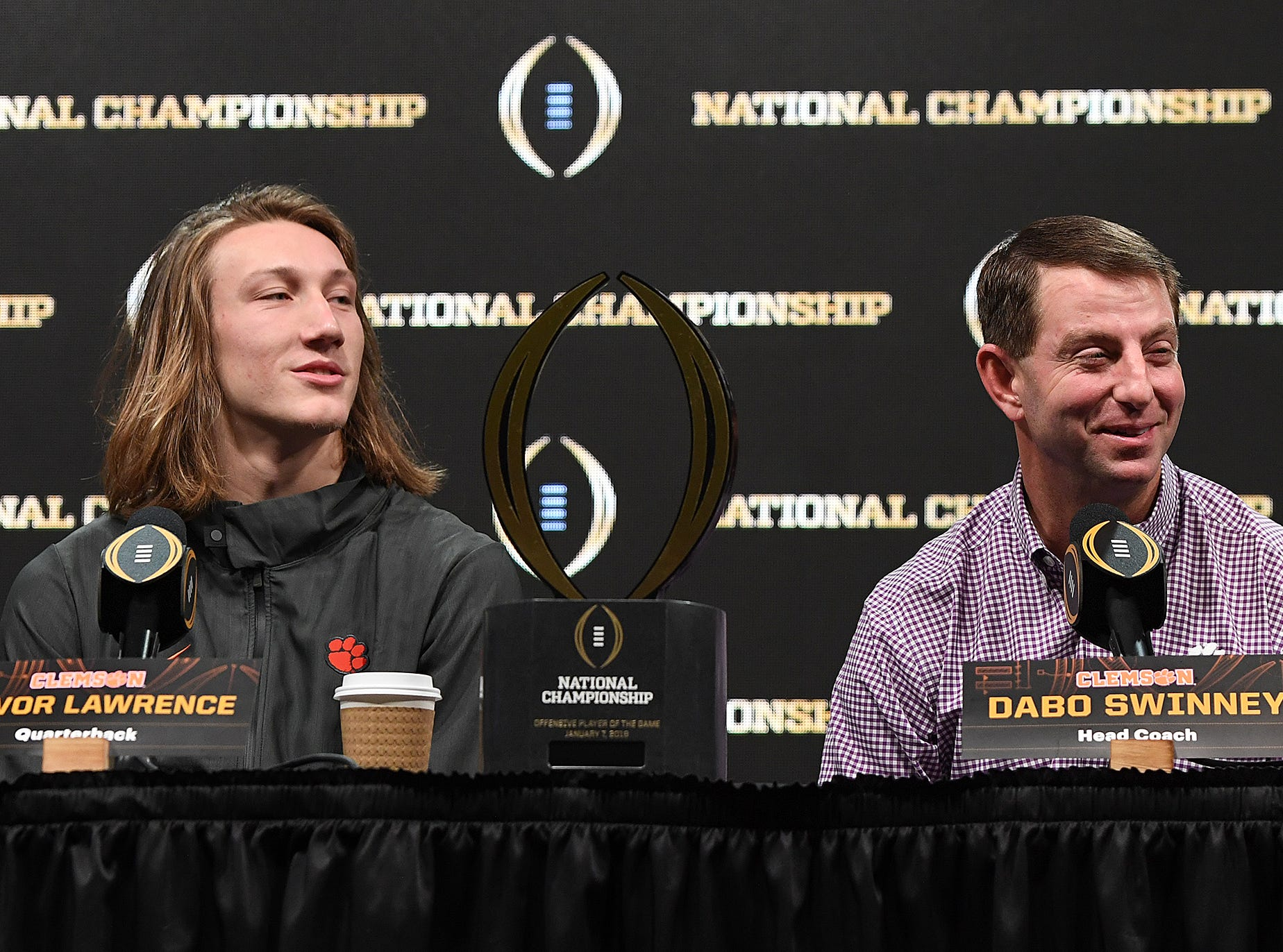 Clemson head coach Dabo Swinney answers questions during the College Football National Championship press conference in San Jose, CA Tuesday, January 8, 2019. Also pictured is Clemson quarterback Trevor Lawrence.