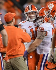 Clemson Head Coach Dabo Swinney, left, quarterback Trevor Lawrence (16) and offensive lineman Gage Cervenka (59) smile in the closing seconds of a 44-16 win over Alabama after the College Football Championship game at Levi's Stadium in Santa Clara, California Monday, January 7, 2019.