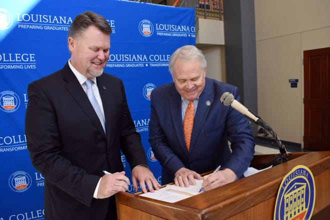 Monty Sullivan (left), system president for Louisiana Community and Technical College, and Rick Brewer, president of Louisiana College, sign an agreement Wednesday, Jan. 9, 2019 that will ensure that coursework of LCTCS students transferring to LC is accepted. Central Louisiana Technical and Community College is part of the LCTCS system.