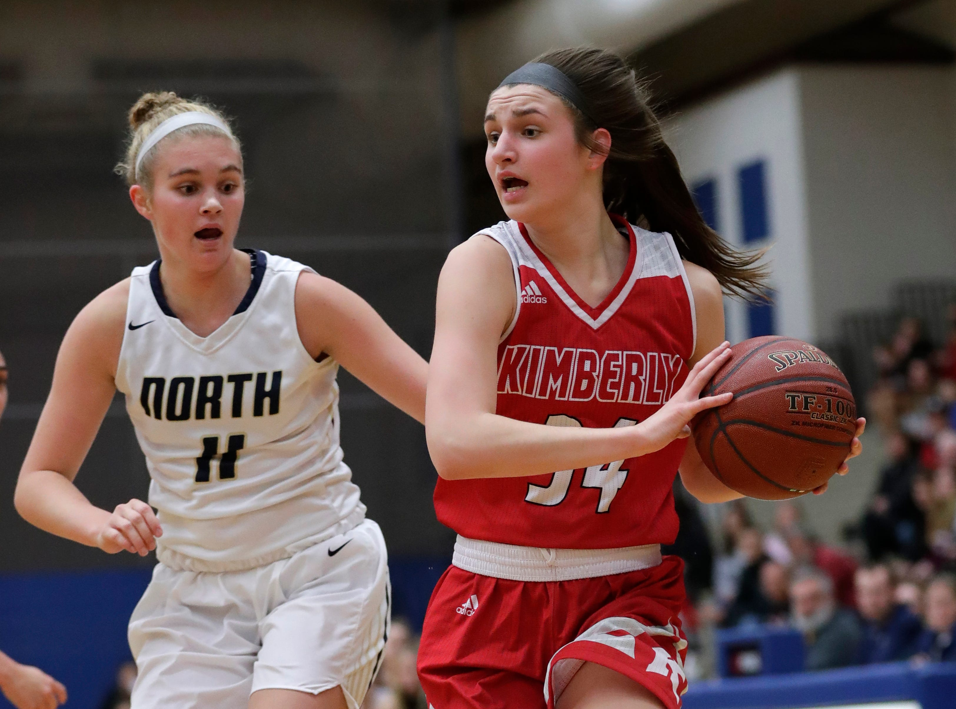 Appleton North High School's Emma Erickson (11) defends against Kimberly High School's Maddy Schreiber (34) during their girls basketball game Tuesday, January 8, 2019, in Appleton, Wis. Dan Powers/USA TODAY NETWORK-Wisconsin