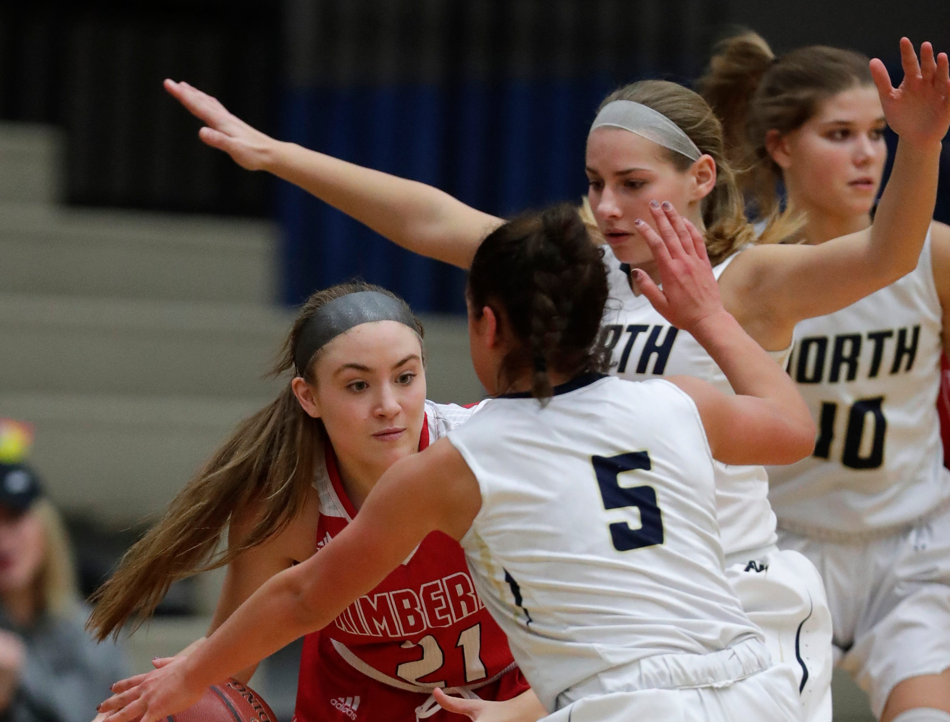 Appleton North High School's Teagan Prusinski (12) and Niki Van Wyk (5) defend against Kimberly High School's Kate Karch (21) during their girls basketball game Tuesday, January 8, 2019, in Appleton, Wis. Dan Powers/USA TODAY NETWORK-Wisconsin