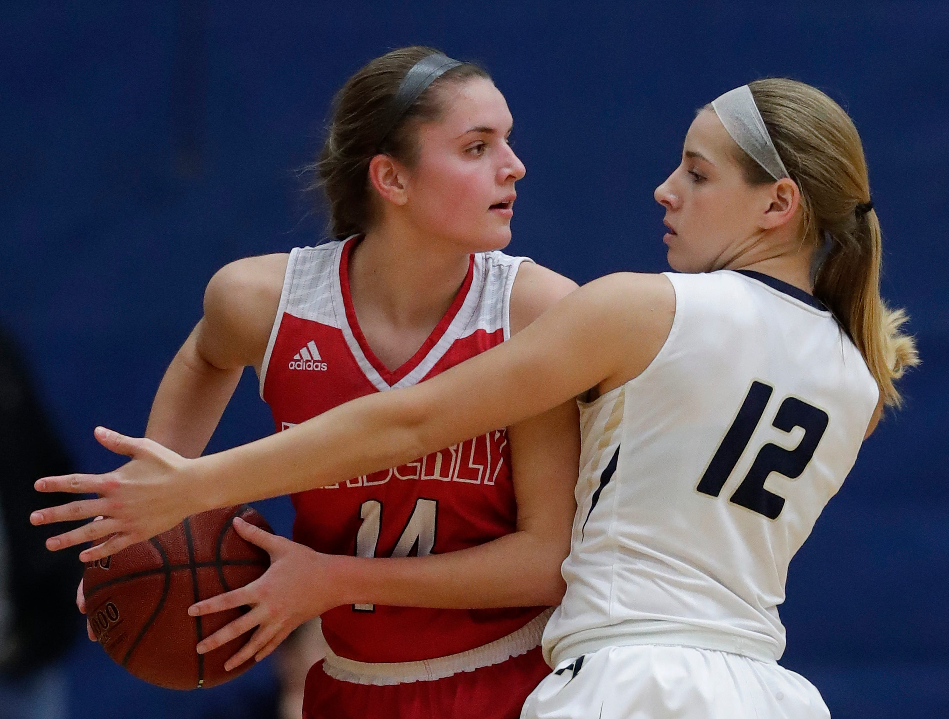 Appleton North High School's Teagan Prusinski (12) defends against Kimberly High School's Taylor Hietpas (14) during their girls basketball game Tuesday, January 8, 2019, in Appleton, Wis. 
