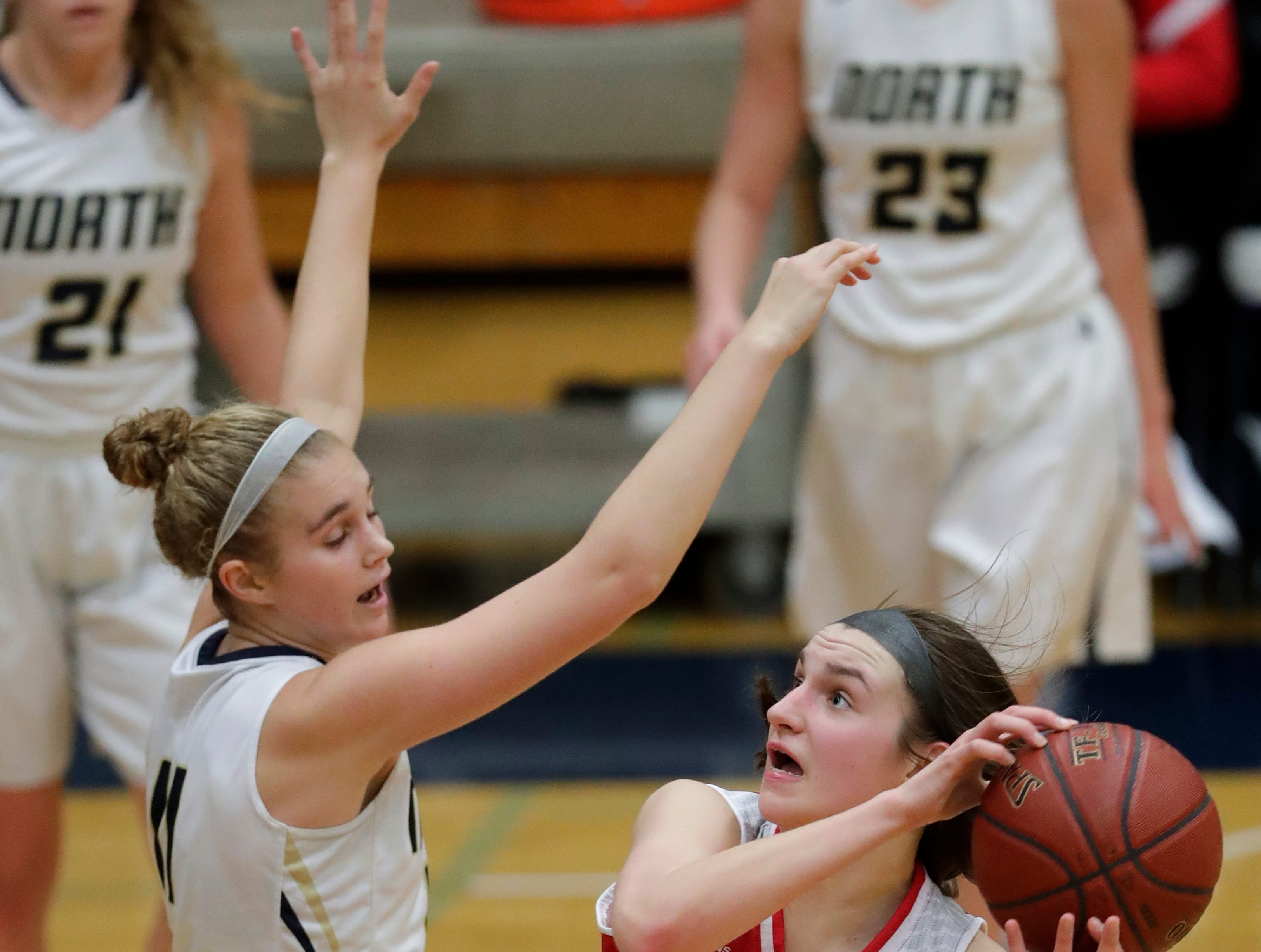Appleton North High School's Emma Erickson (11) defends against Kimberly High School's Maddy Schreiber (34) during their girls basketball game Tuesday, January 8, 2019, in Appleton, Wis. 