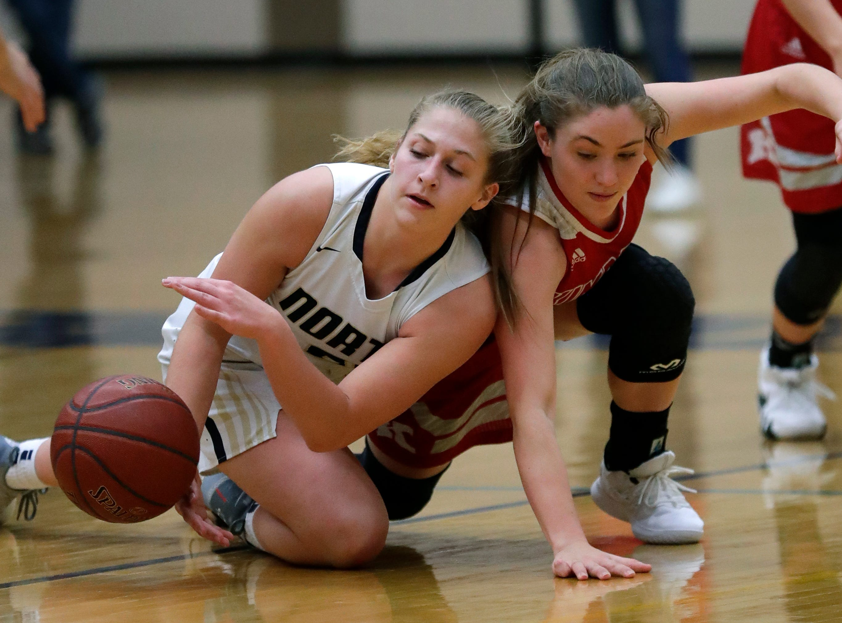 Appleton North High School's Lilli Van Handel (21) scrambles for the ball against Kimberly High School's Kate Karch (21) during their girls basketball game Tuesday, January 8, 2019, in Appleton, Wis. 