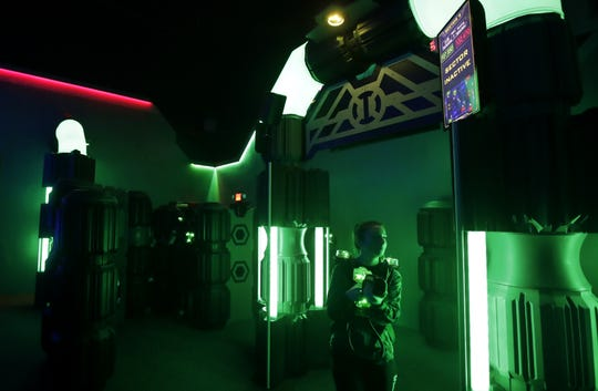 Jordann Thiel, a senior at Kimberly High School, plays a round of laser tag at Badger Sports Park Tuesday. Badger Sports Park's laser tag arena underwent a massive overhaul in the fall.