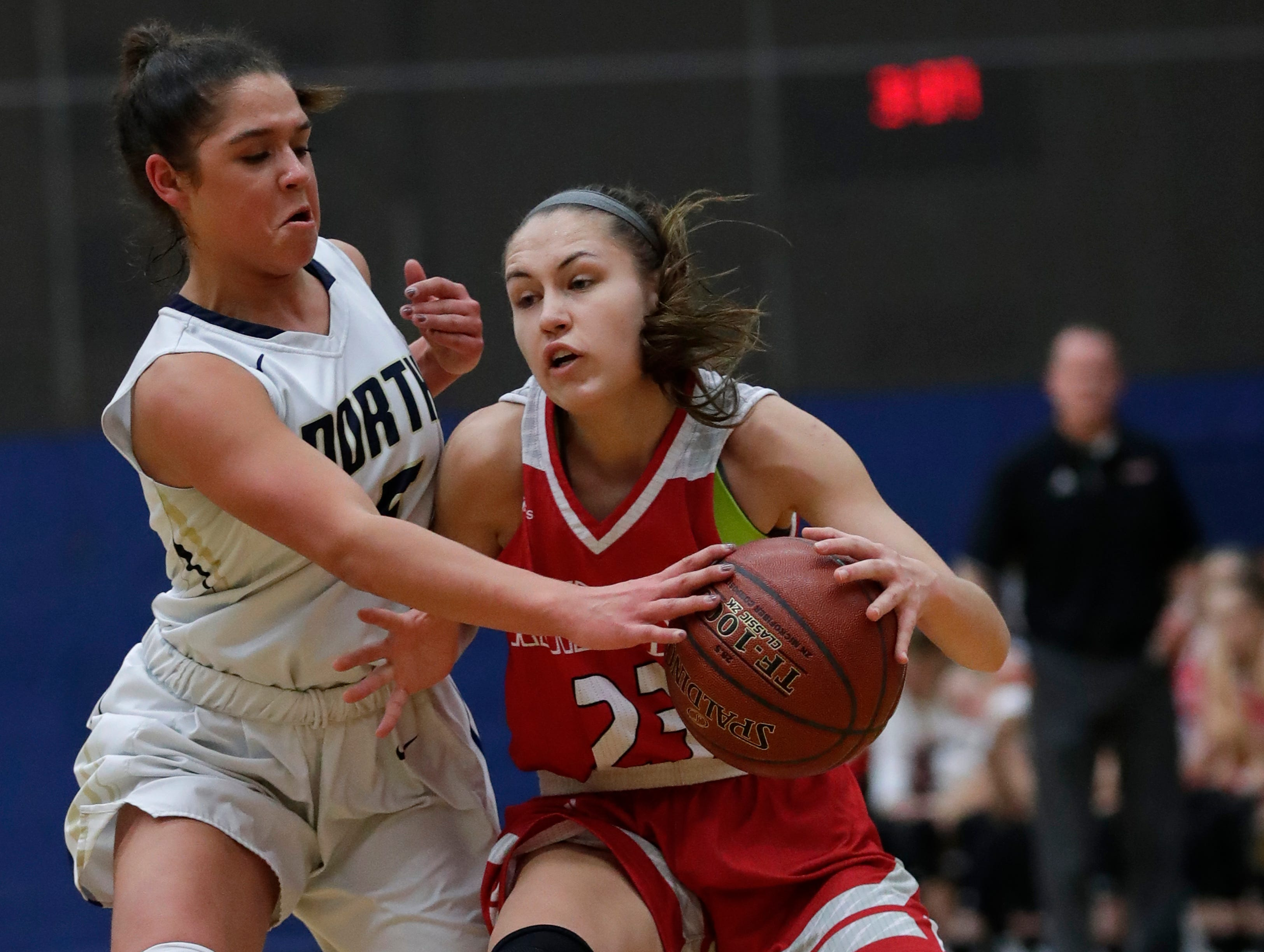 Appleton North High School's Niki Van Wyk (5) defends against Kimberly High School's Bryn Sikora (23) during their girls basketball game Tuesday, January 8, 2019, in Appleton, Wis. Dan Powers/USA TODAY NETWORK-Wisconsin