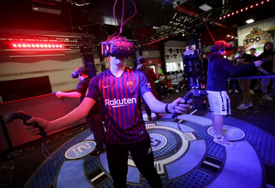Eli Ruplinger, a senior at Kimberly High School, uses the new Hologate virtual reality gaming system at Badger Sports Park in Appleton Tuesday.