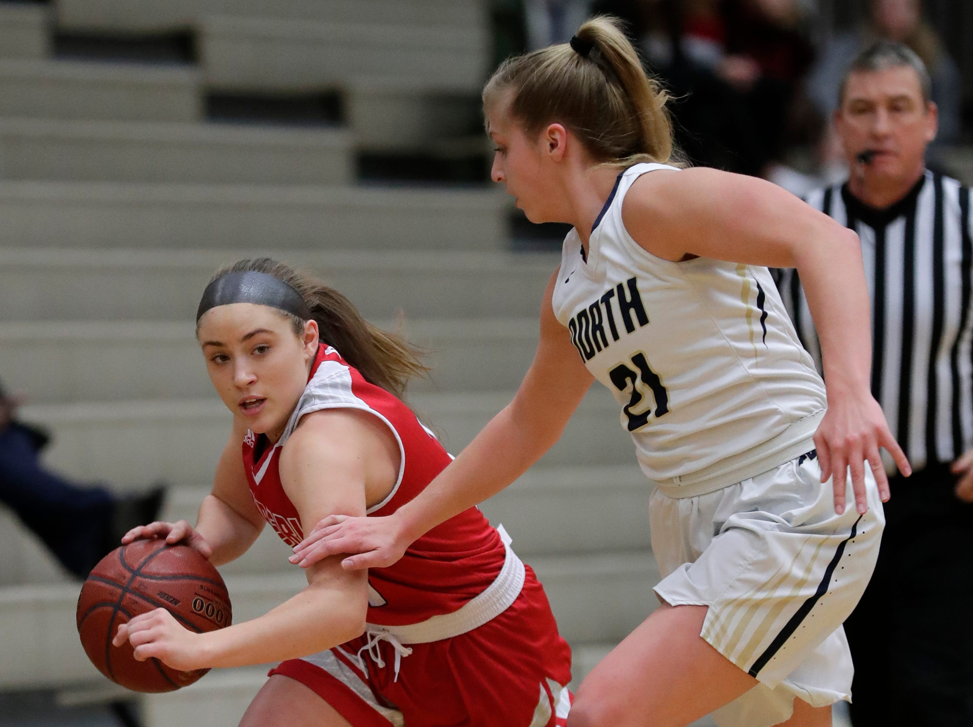 Kimberly High School's Kiara Schmidt (12) tries to get past Appleton North High School's Lilli Van Handel (21) during their girls basketball game Tuesday, January 8, 2019, in Appleton, Wis. 
