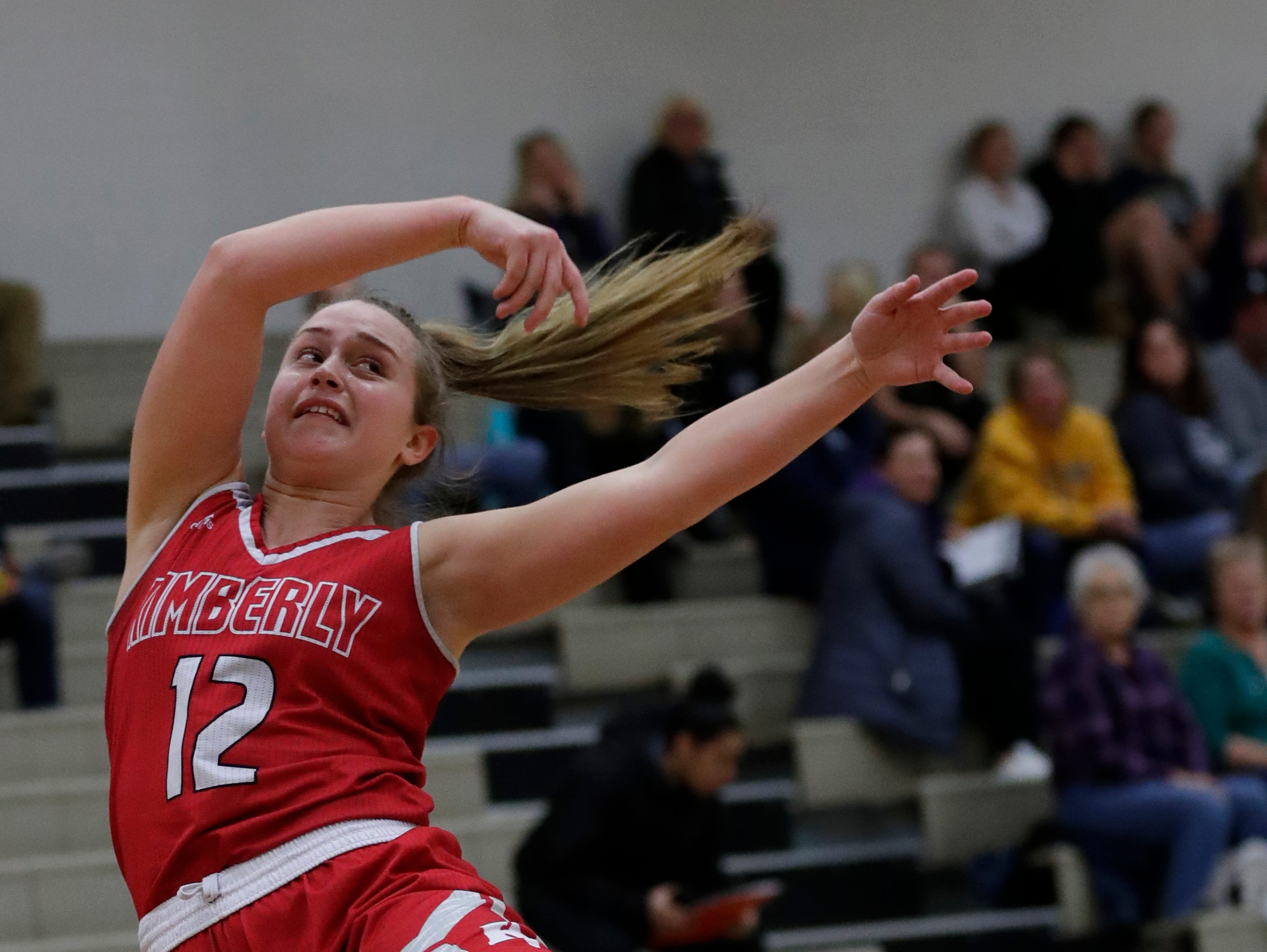 Kimberly High School's Kiara Schmidt (12) tries to keep the ball from going out of bounds against Appleton North High School during their girls basketball game Tuesday, January 8, 2019, in Appleton, Wis. 