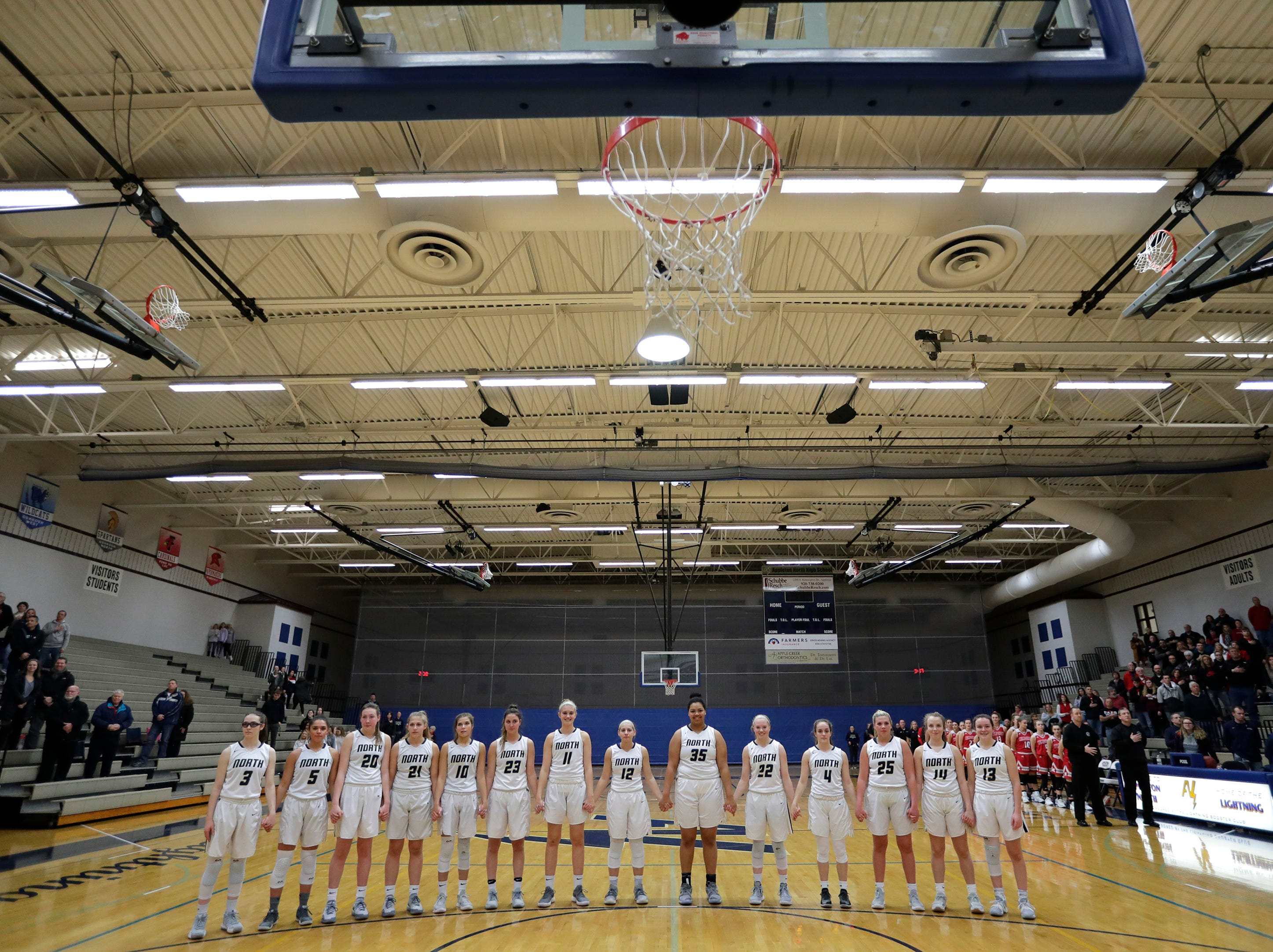 Appleton North High School's players hold hands during the national anthem before playing against Kimberly High School during their girls basketball game Tuesday, January 8, 2019, in Appleton, Wis. Dan Powers/USA TODAY NETWORK-Wisconsin