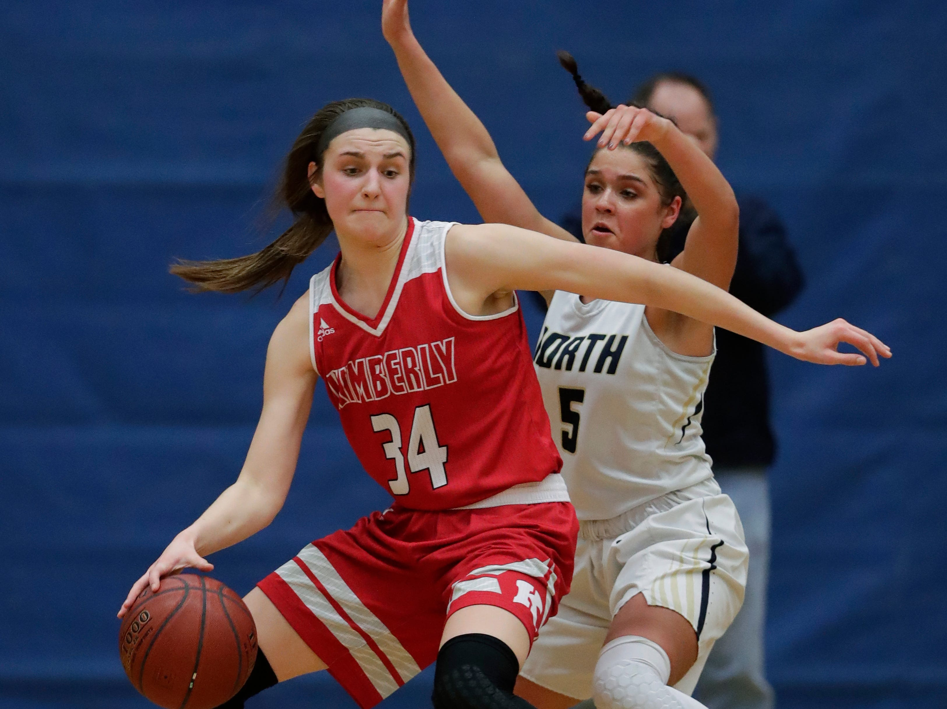 Appleton North High School's Niki Van Wyk (5) defends against Kimberly High School's Maddy Schreiber (34) during their girls basketball game Tuesday, January 8, 2019, in Appleton, Wis. 