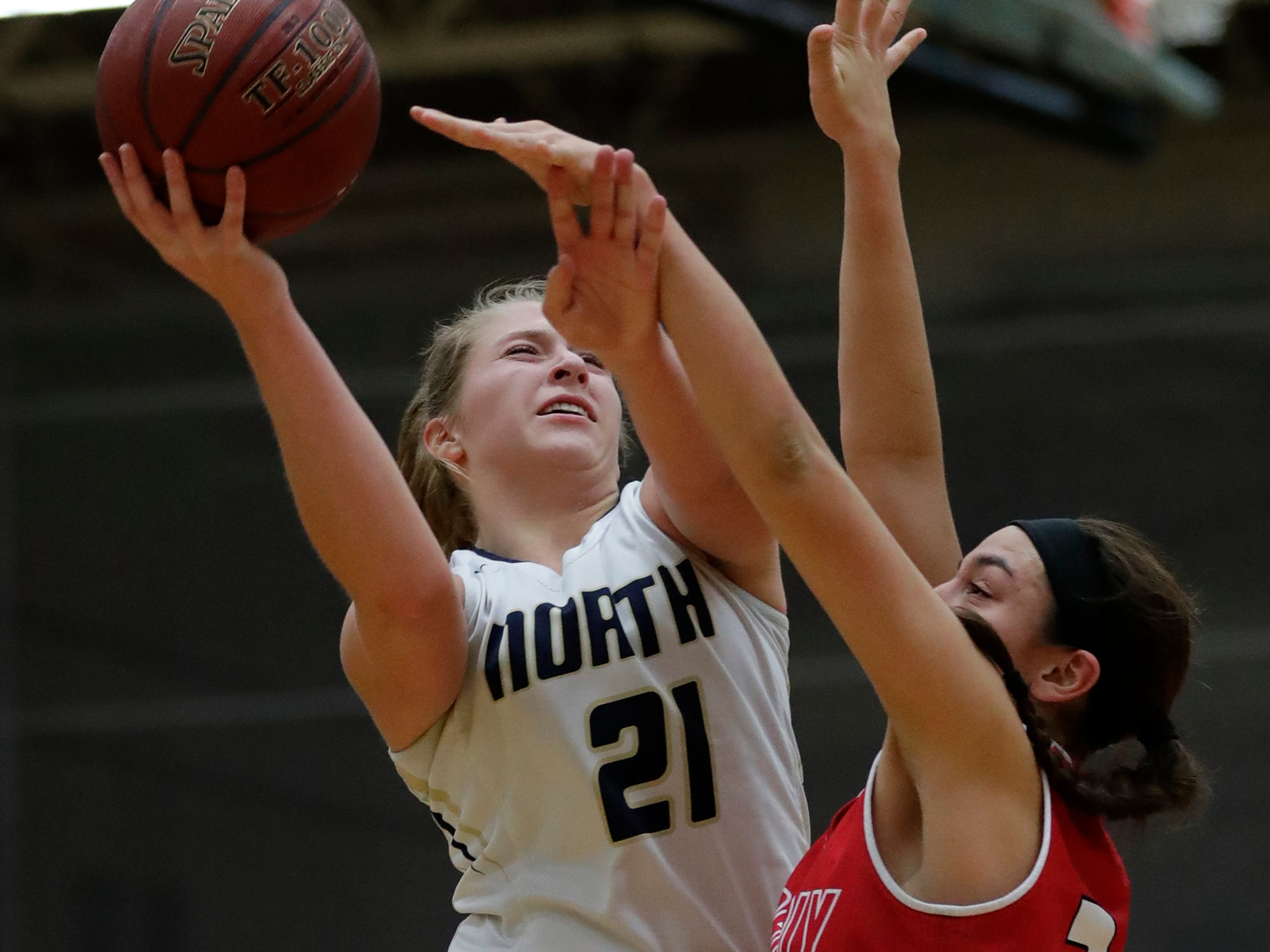 Appleton North High School's Lilli Van Handel (21) puts up a shot against Kimberly High School's Shea Dechant (24) during their girls basketball game Tuesday, January 8, 2019, in Appleton, Wis. Dan Powers/USA TODAY NETWORK-Wisconsin