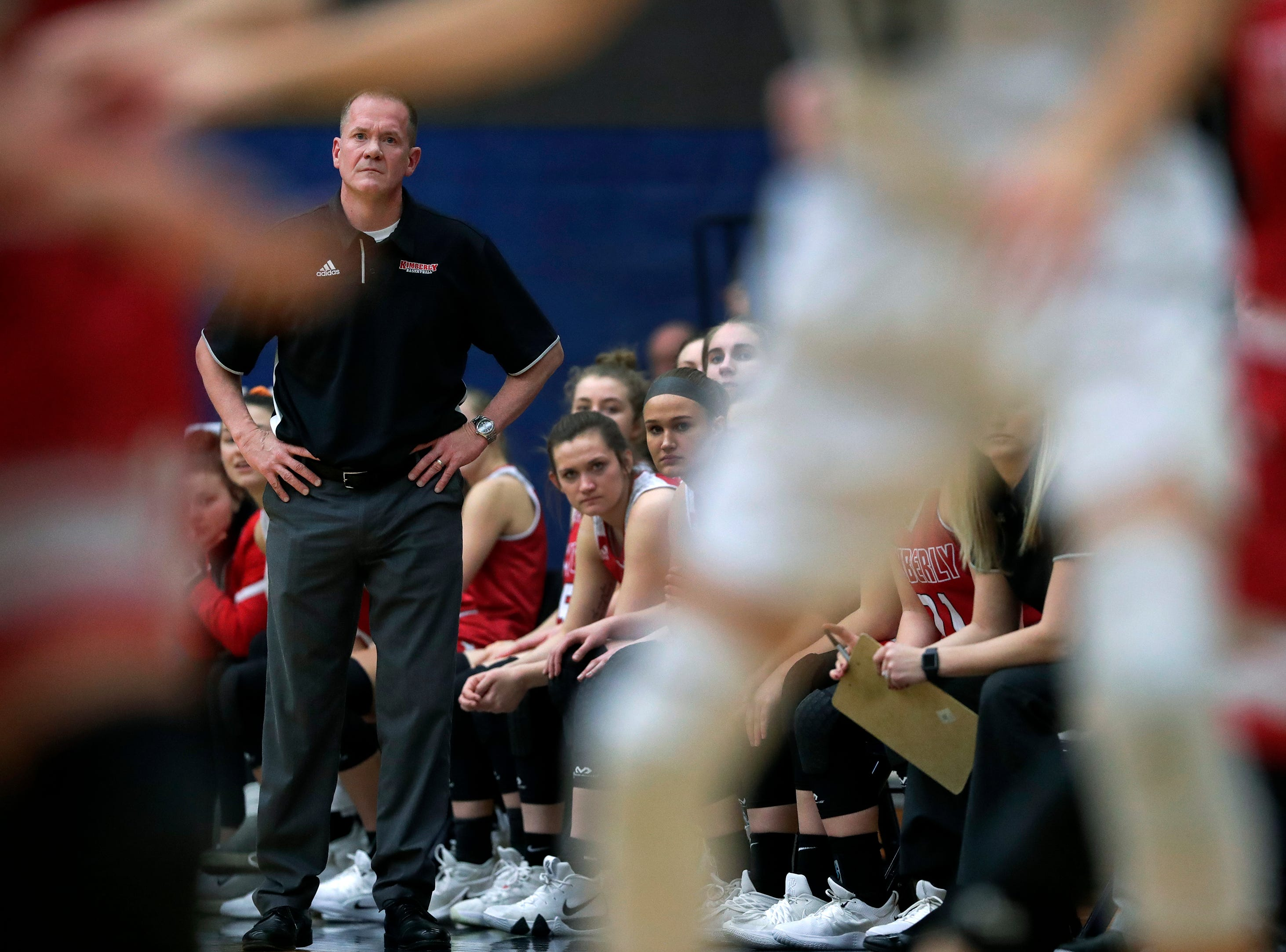 Kimberly High School's coach Troy Cullen keeps his eyes on the action against Appleton North High School during their girls basketball game Tuesday, January 8, 2019, in Appleton, Wis. 