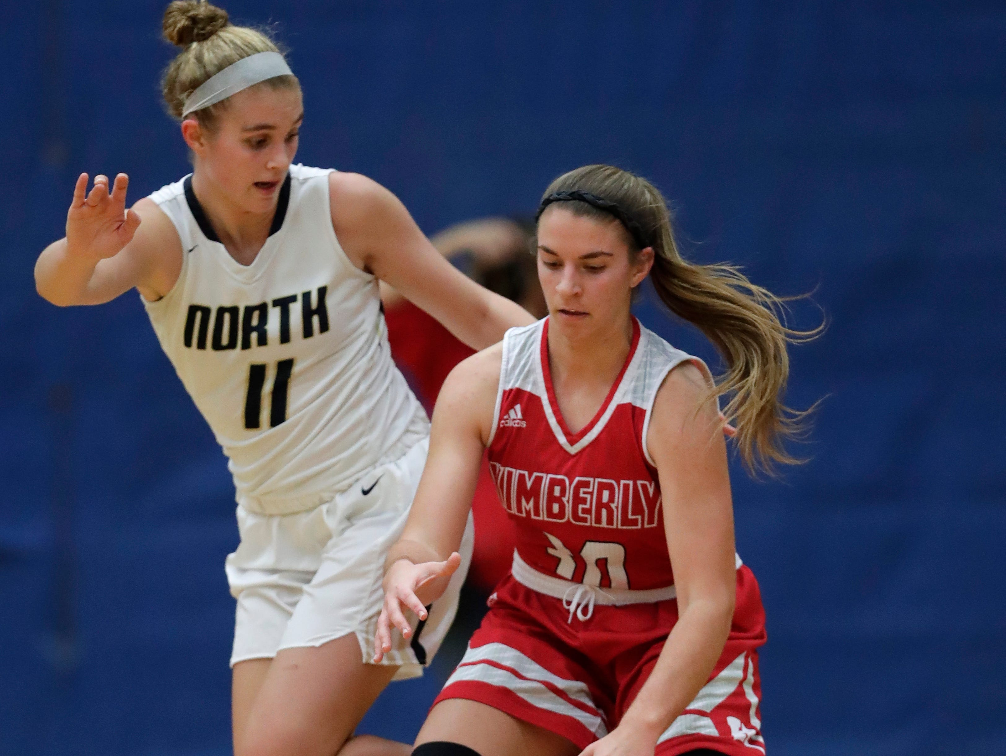 Appleton North High School's Emma Erickson (11) defends against Kimberly High School's Marissa Murray (30) during their girls basketball game Tuesday, January 8, 2019, in Appleton, Wis. Dan Powers/USA TODAY NETWORK-Wisconsin