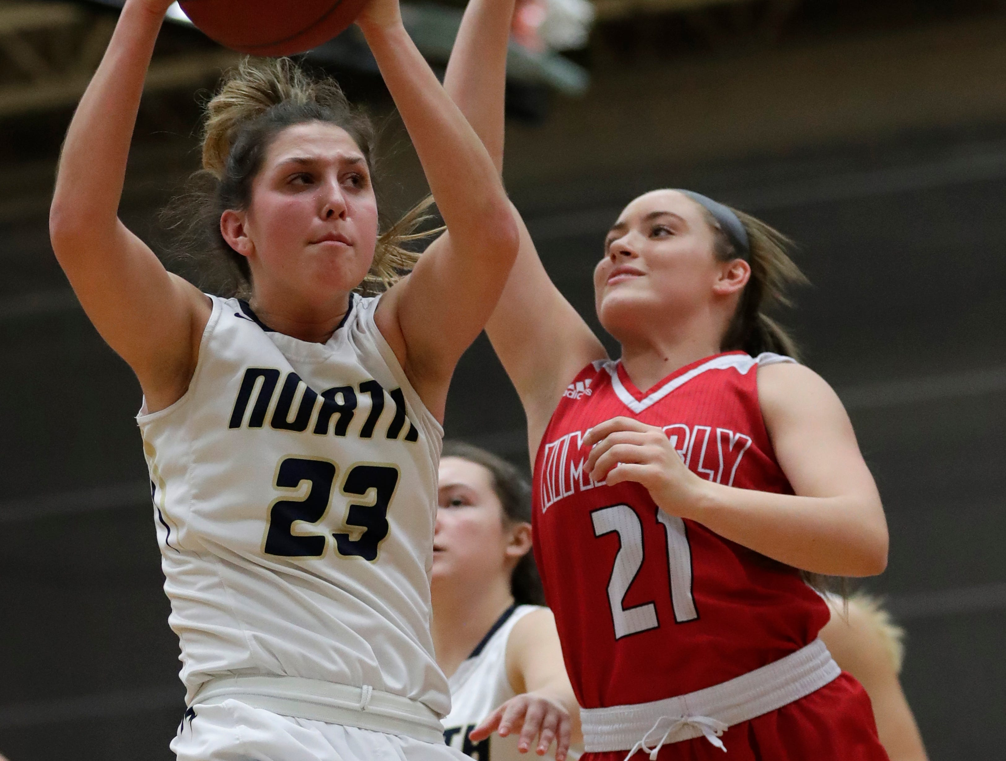 Appleton North High School's Paige Schabo (23) pulls down a rebound against Kimberly High School's Kate Karch (21) during their girls basketball game Tuesday, January 8, 2019, in Appleton, Wis. Dan Powers/USA TODAY NETWORK-Wisconsin