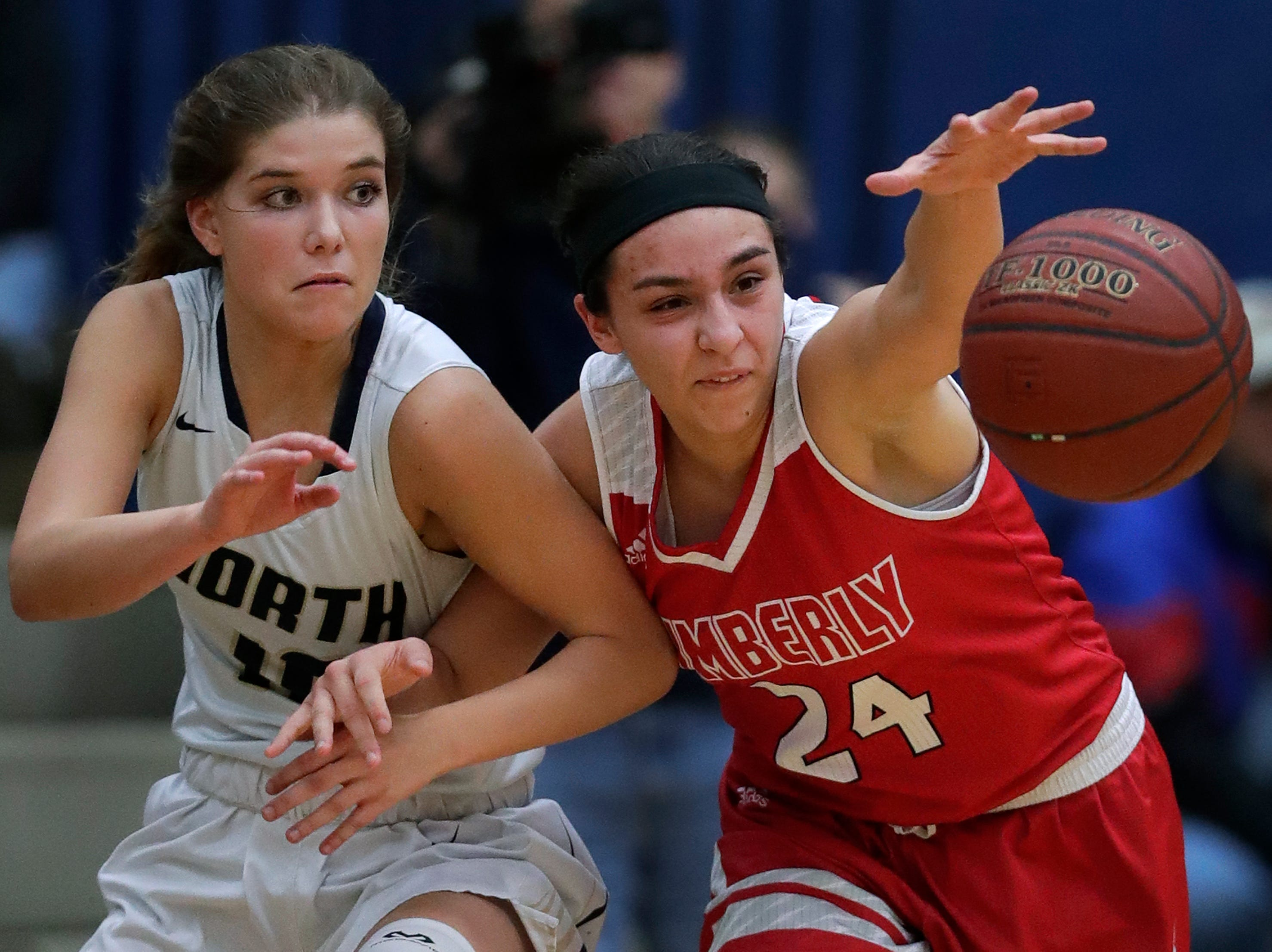 Appleton North High School's Anna Laux (10) and Kimberly High School's Shea Dechant (24) try to gain control of the ball during their girls basketball game Tuesday, January 8, 2019, in Appleton, Wis. Dan Powers/USA TODAY NETWORK-Wisconsin