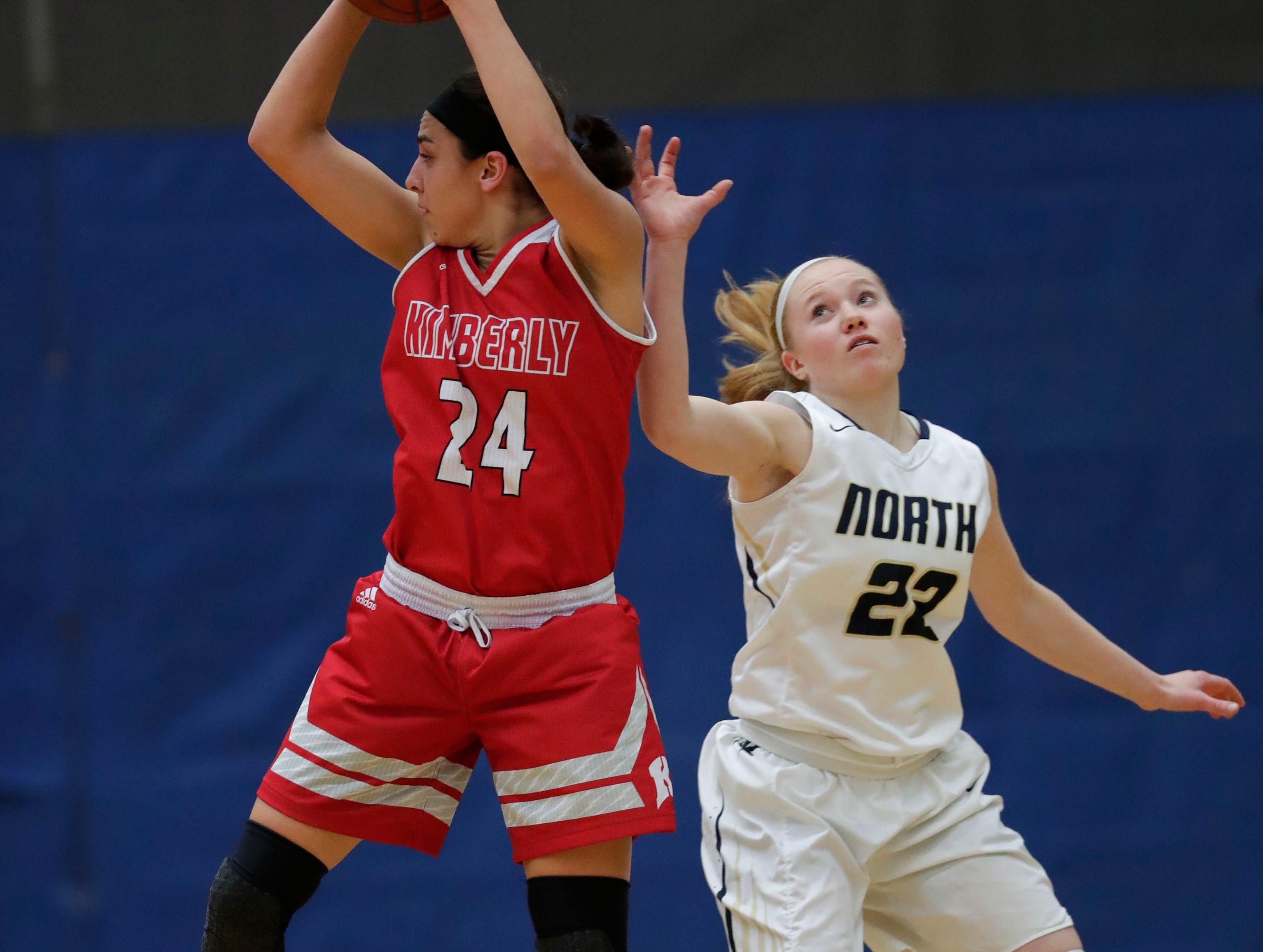 Kimberly High School's Shea Dechant (24) looks to pass the ball against Appleton North High School's Kennedy Litvinoff (22) during their girls basketball game Tuesday, January 8, 2019, in Appleton, Wis. Dan Powers/USA TODAY NETWORK-Wisconsin