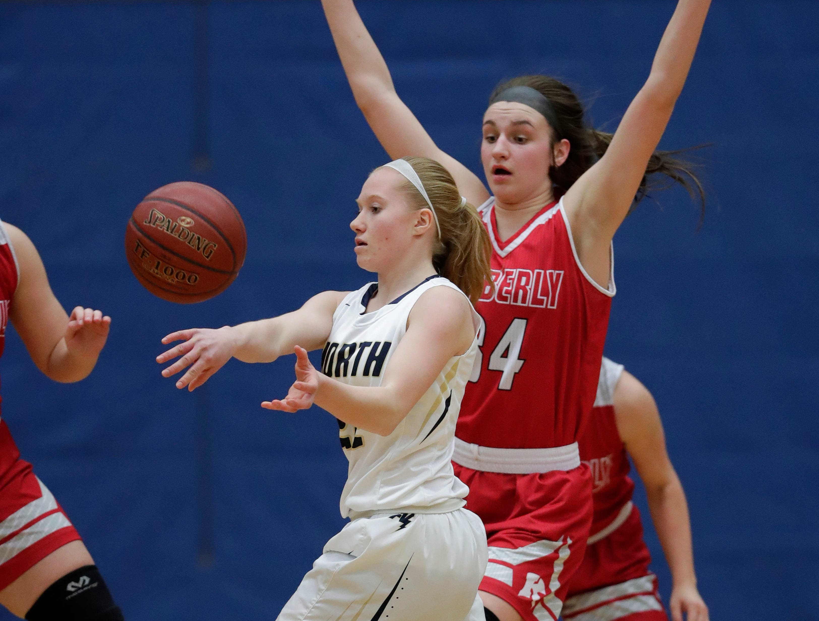 Appleton North High School's Kayla Schroeder (22) pass the ball against Kimberly High School's Maddy Schreiber (34) during their girls basketball game Tuesday, January 8, 2019, in Appleton, Wis. Dan Powers/USA TODAY NETWORK-Wisconsin